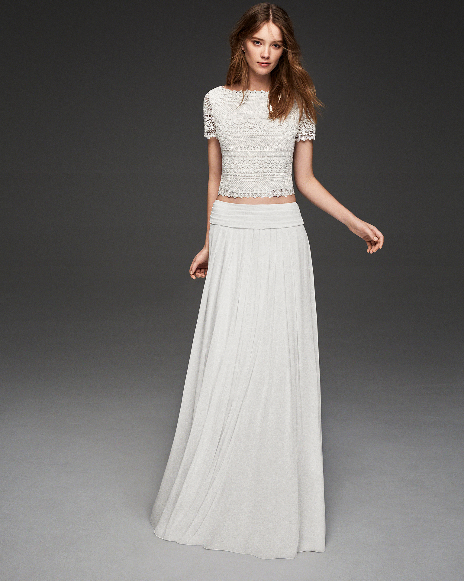 Boho-style three-piece crepe Georgette and guipure lace wedding dress with short sleeves.