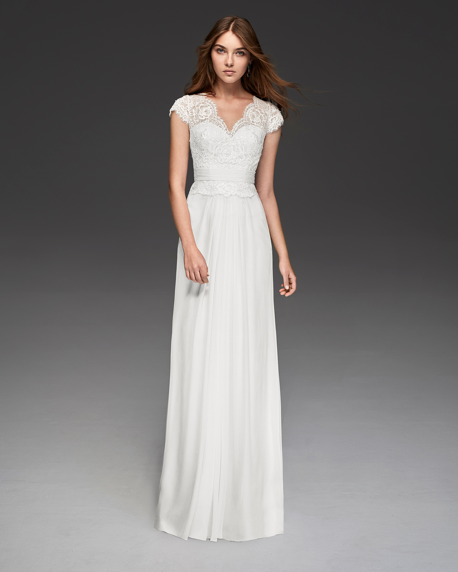 Boho-style beaded crepe Georgette wedding dress with short sleeves and V-neckline.