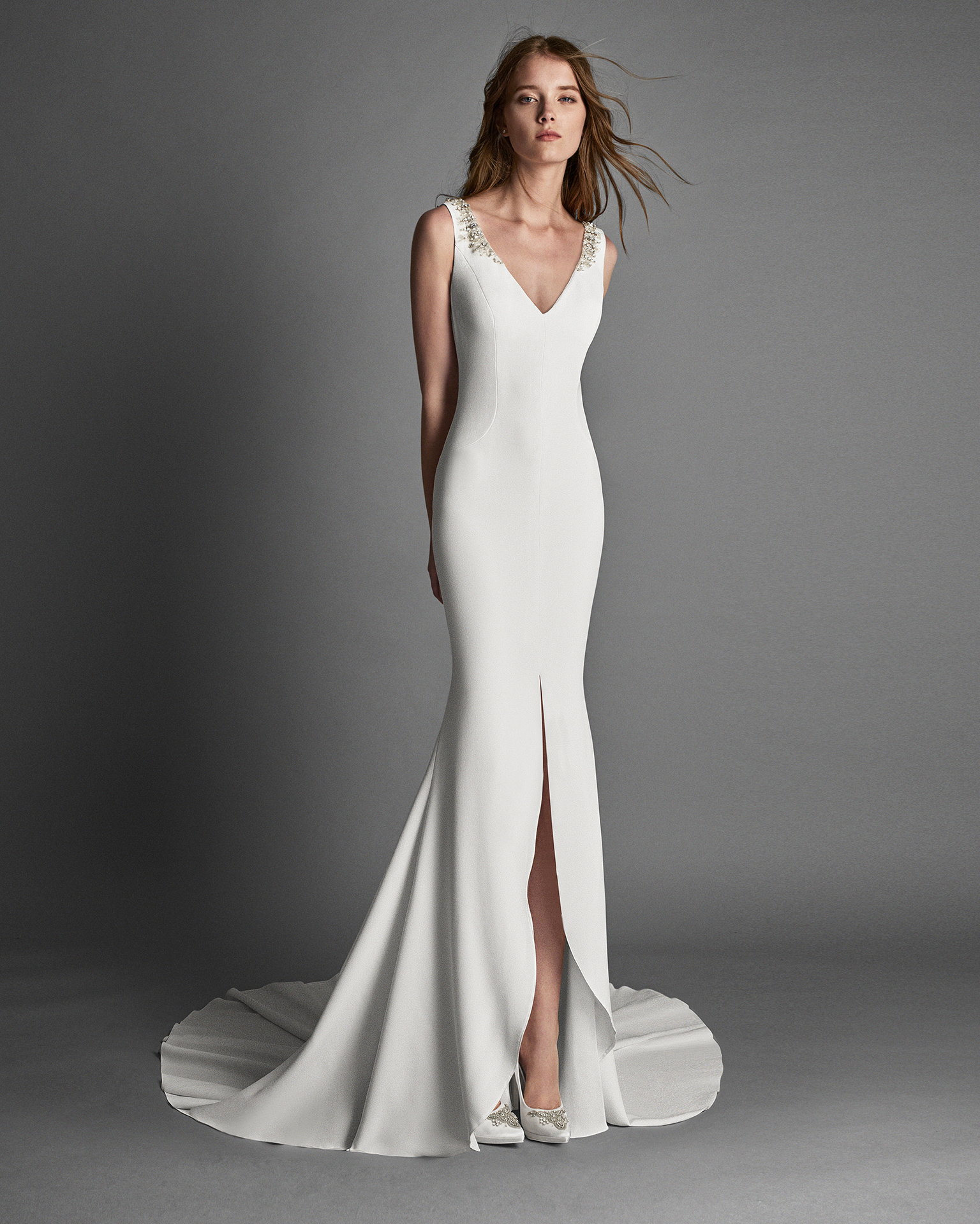 Mermaid-style crepe wedding dress with front opening and crystal flowers on back.