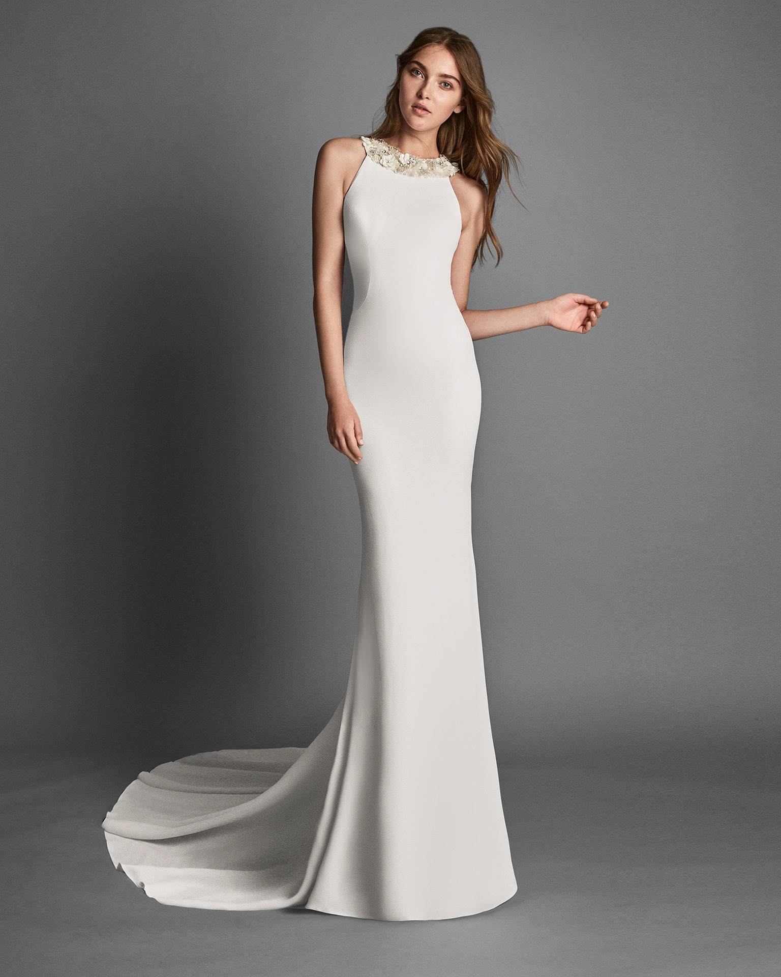 Mermaid-style crepe wedding dress with halter neckline, low back and crystal flower detail.