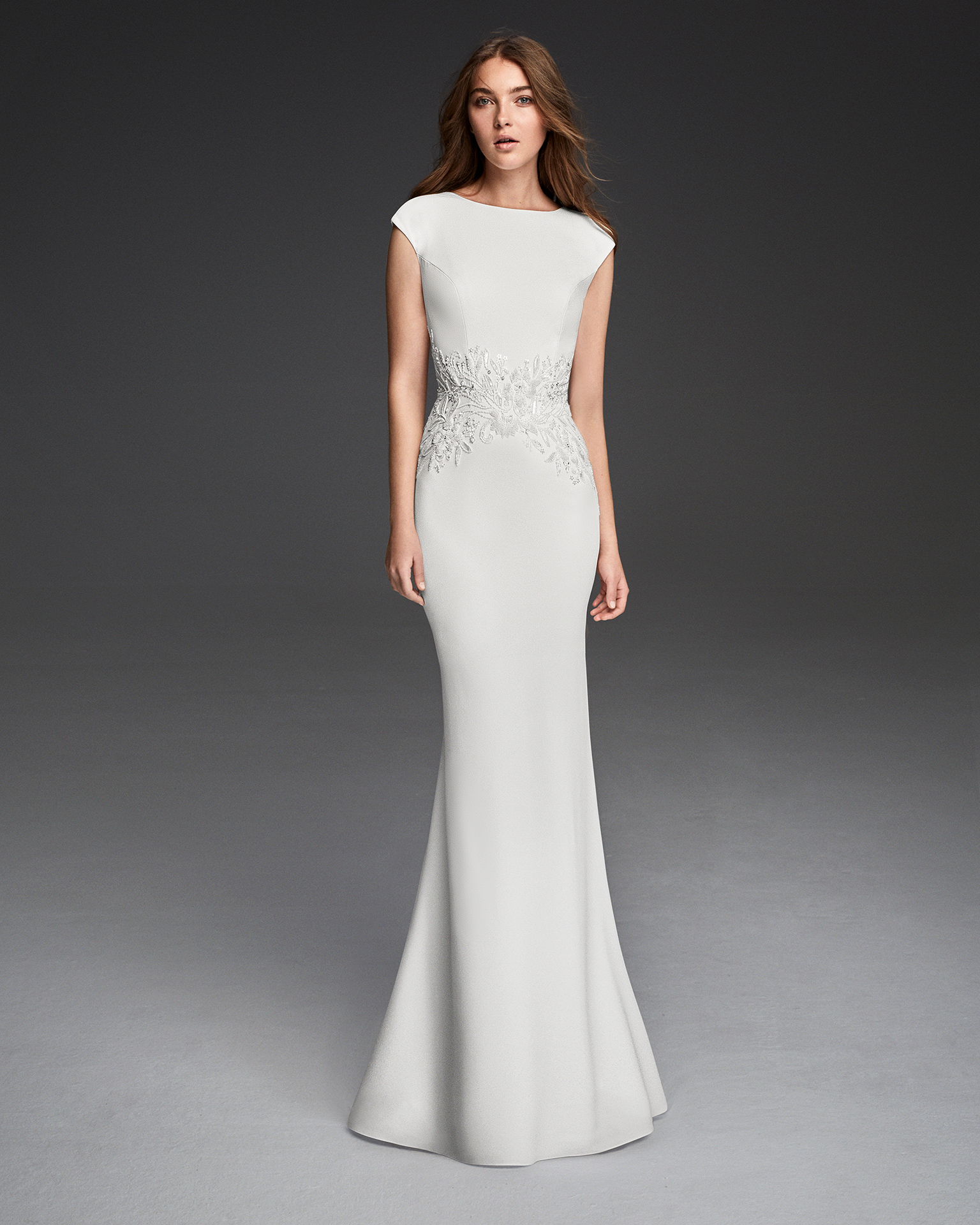 Crepe sheath wedding dress with short sleeves, low back and beadwork detail.