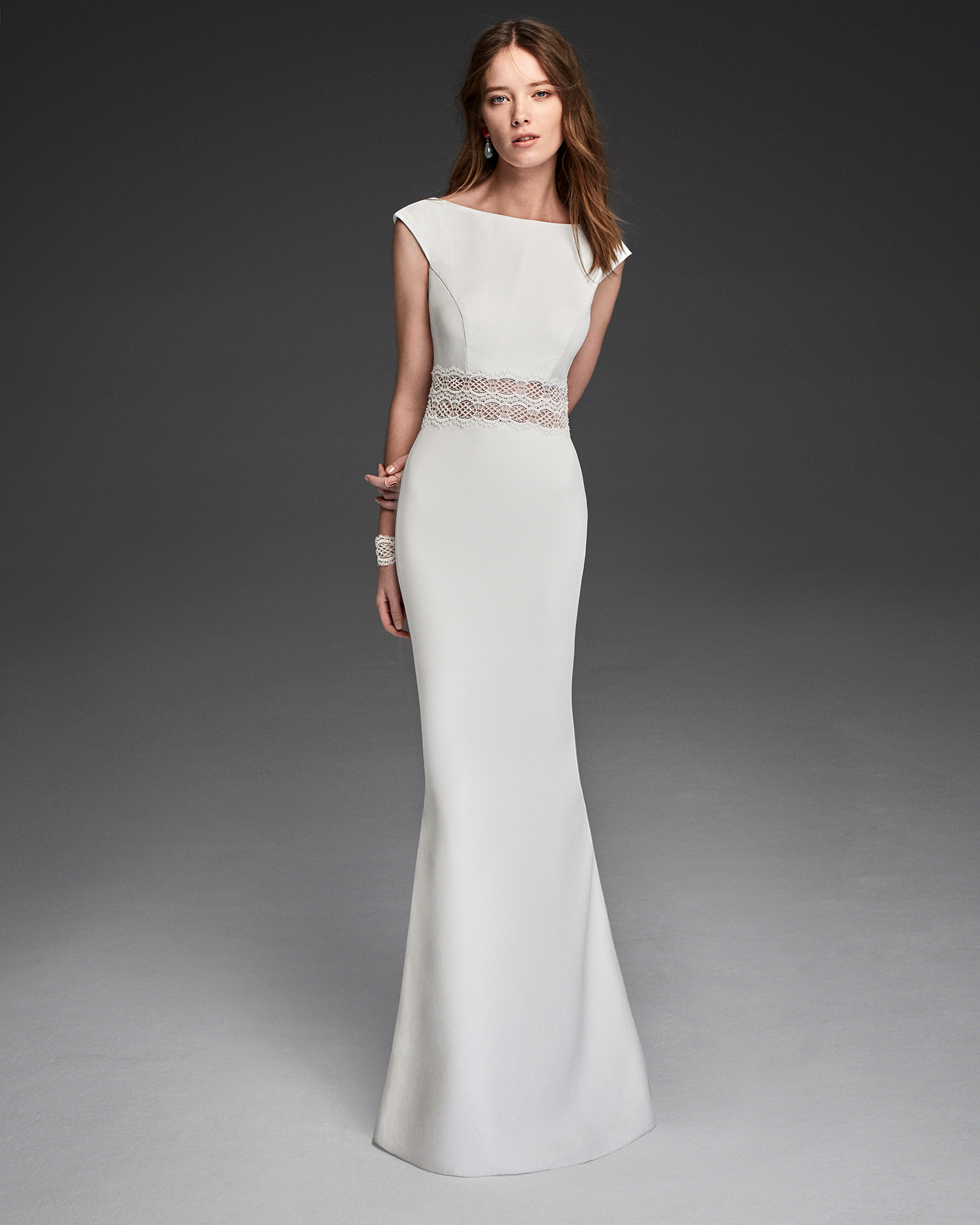 Boho-style crepe and guipure lace wedding dress with short sleeves and low back.