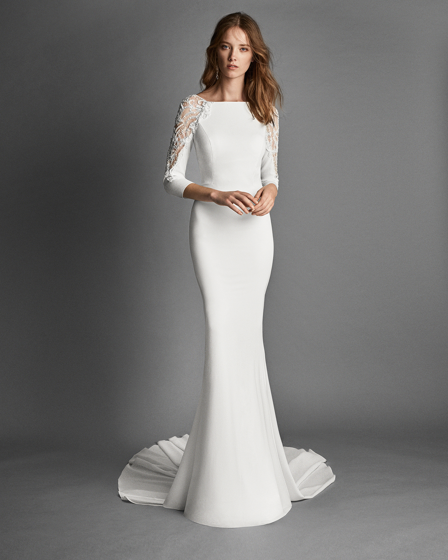 Mermaid-style crepe Georgette wedding dress with long sleeves and jewelled back.