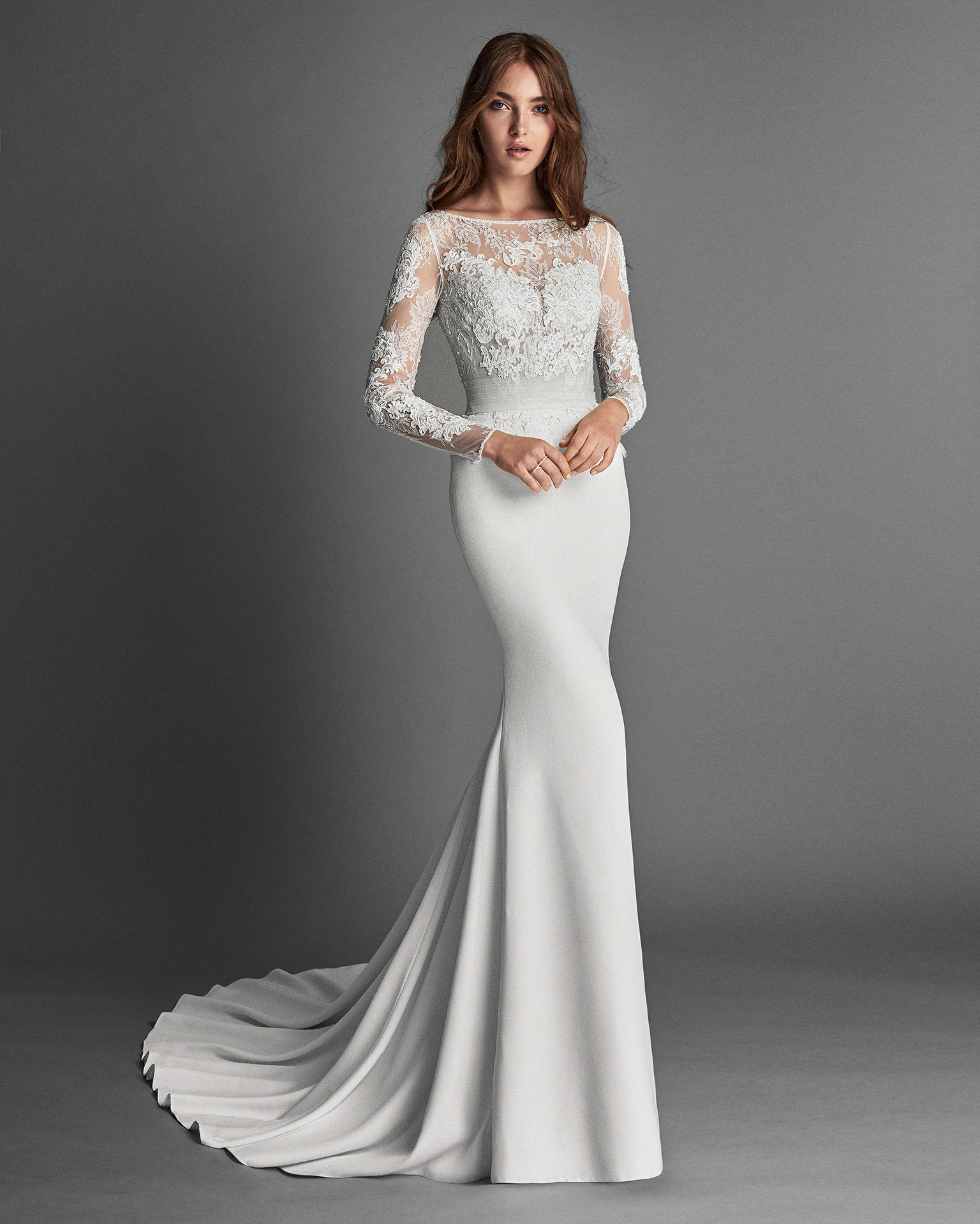 Mermaid-style crepe and lace wedding dress with long sleeves, bateau neckline, low back and beadwork detail, in natural.