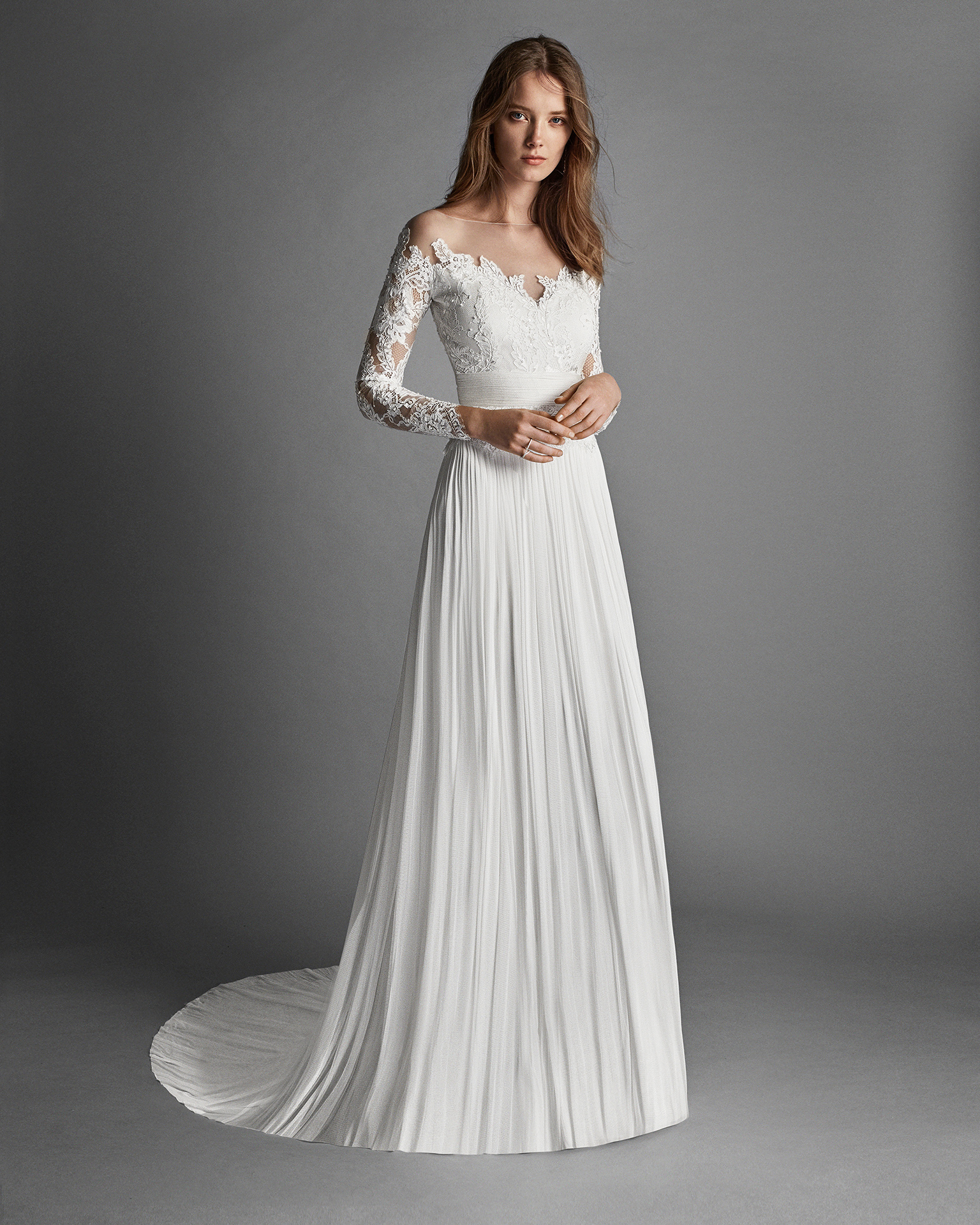 Classic-style muslin and lace wedding dress with long sleeves, low back and beadwork detail.
