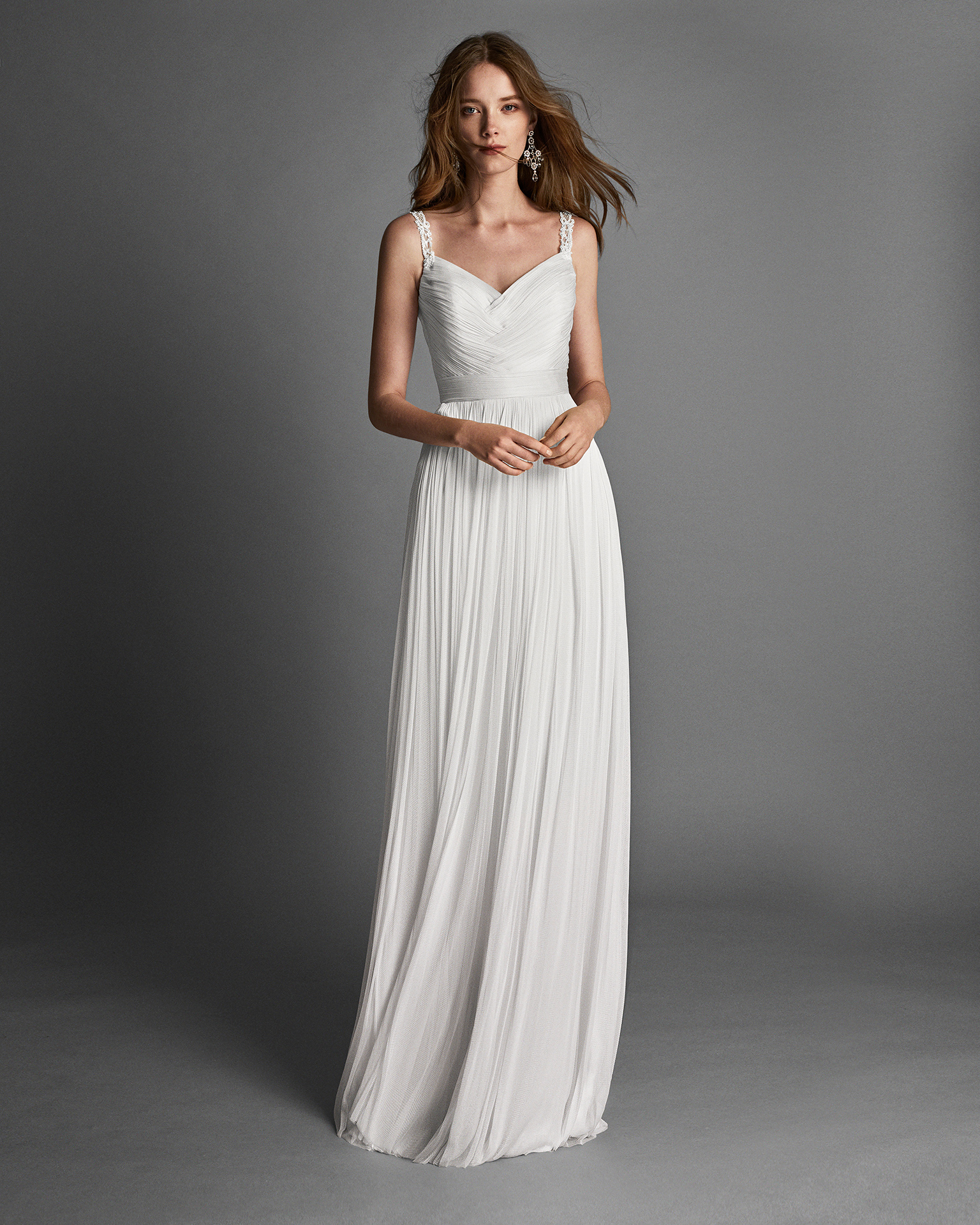 Muslin sheath wedding dress with jewelled back and beadwork detail.