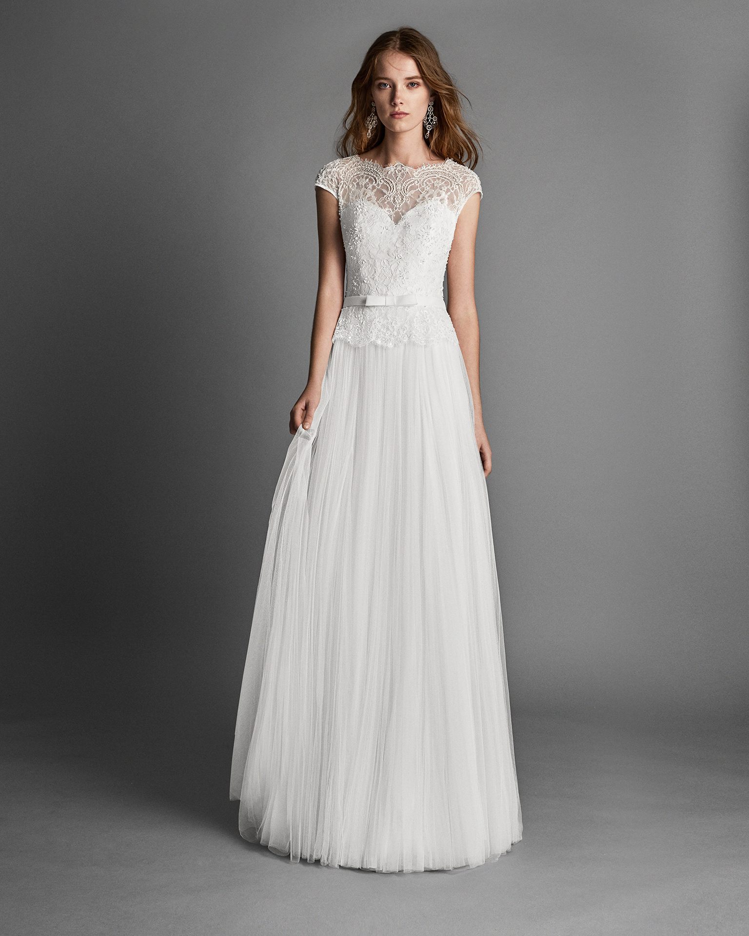 A-line tulle and lace wedding dress with short sleeves, and low back with beadwork detail.