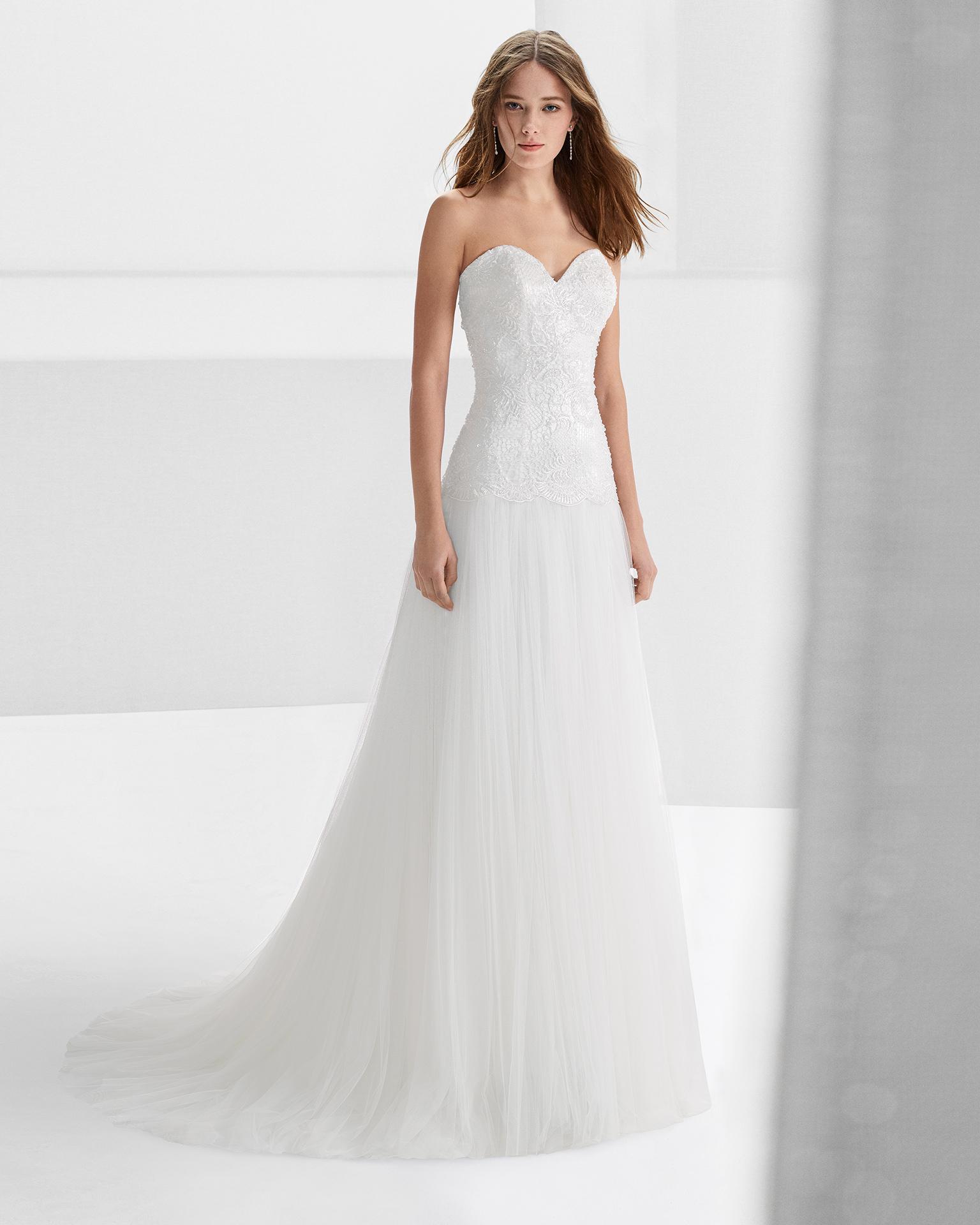 Beaded tulle sheath wedding dress with sweetheart neckline.