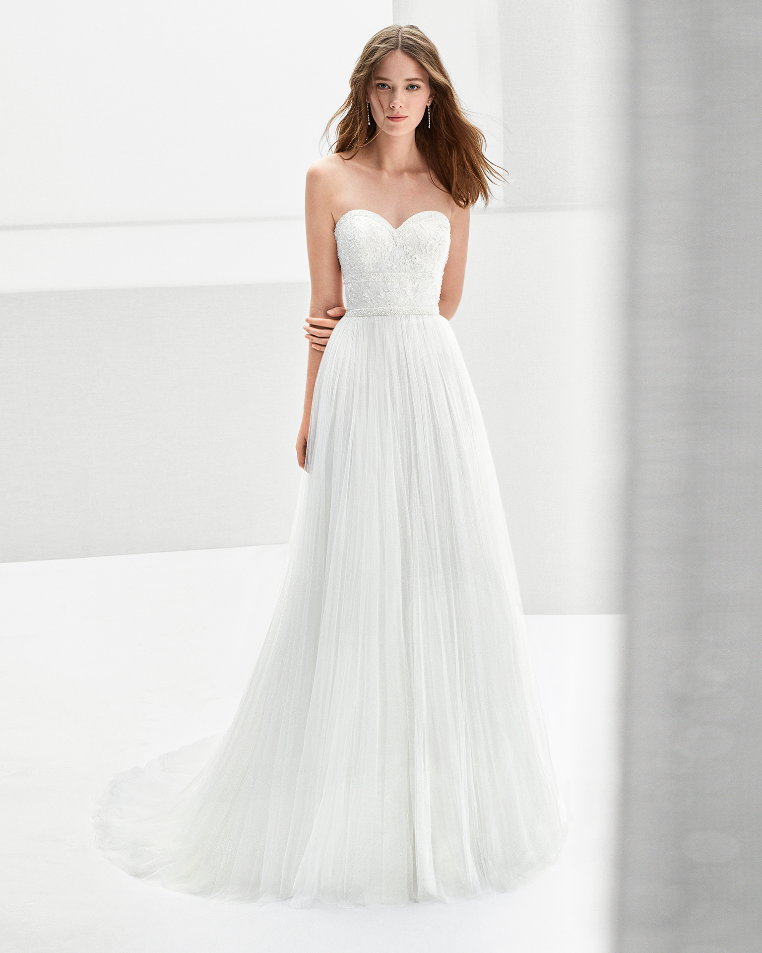 A-line beaded tulle wedding dress with sweetheart neckline and low back.