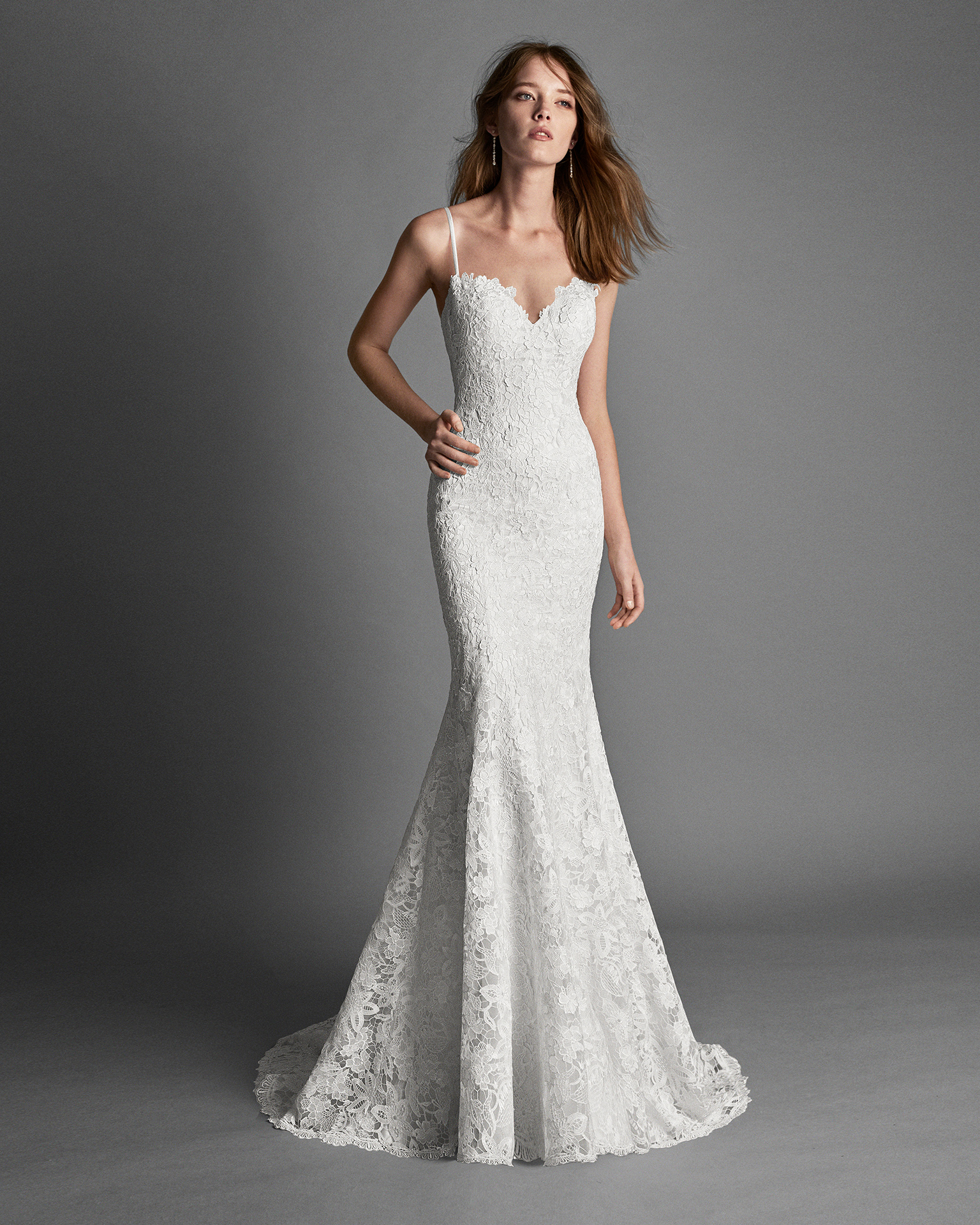 Mermaid-style guipure lace wedding dress with low back.