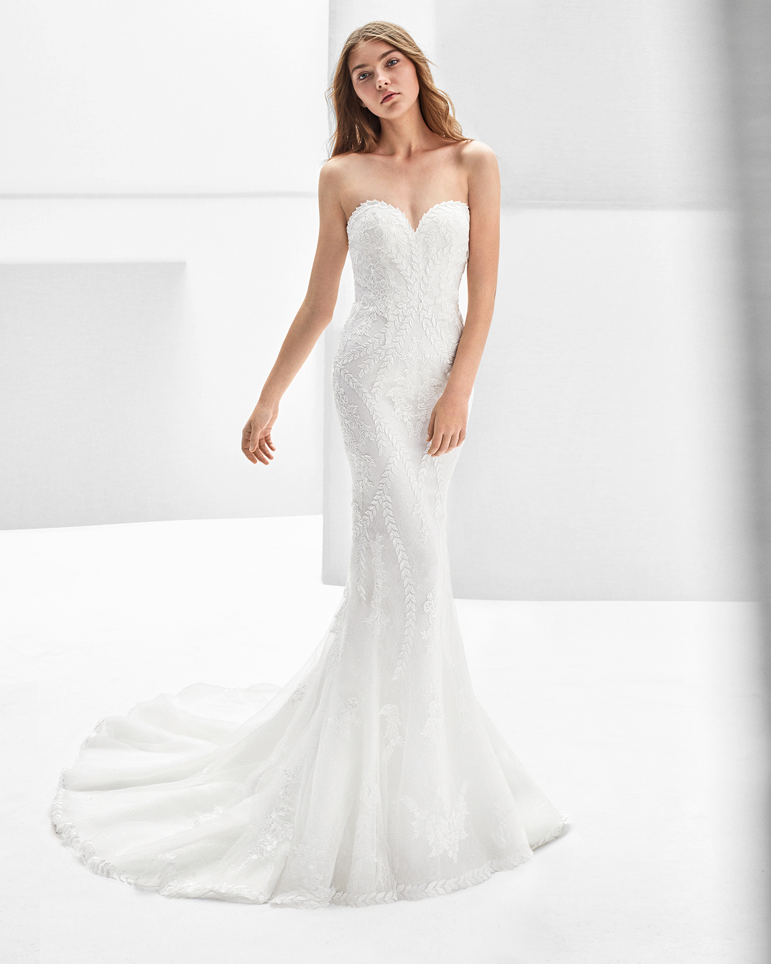 Mermaid-style beaded guipure lace wedding dress with sweetheart neckline and low back.