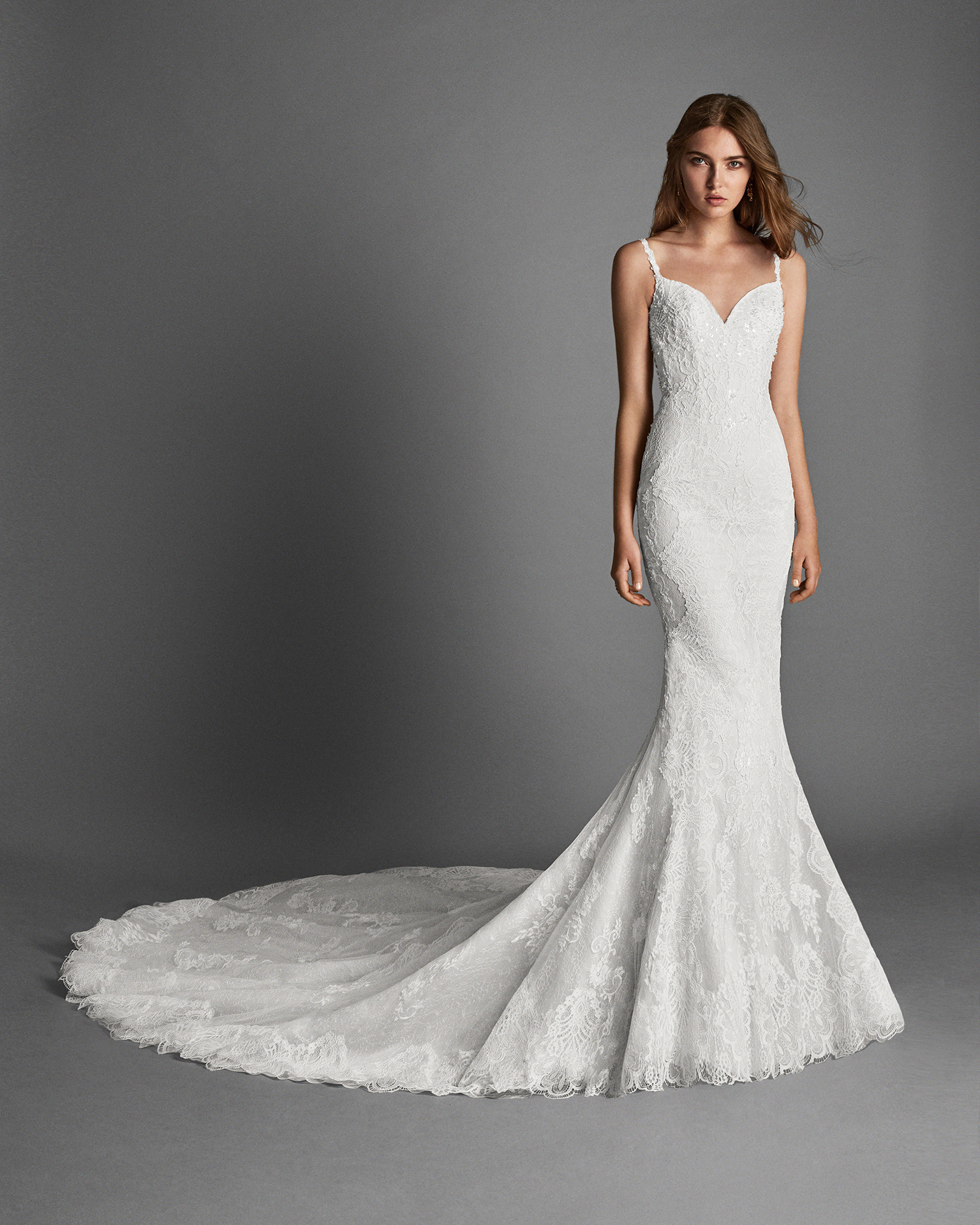 Mermaid-style beaded lace wedding dress with low back.