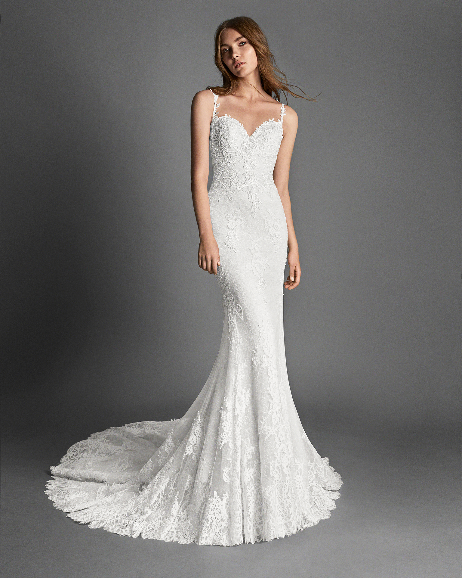 Mermaid-style beaded lace and guipure lace wedding dress with sweetheart neckline, low back and lace appliqués.