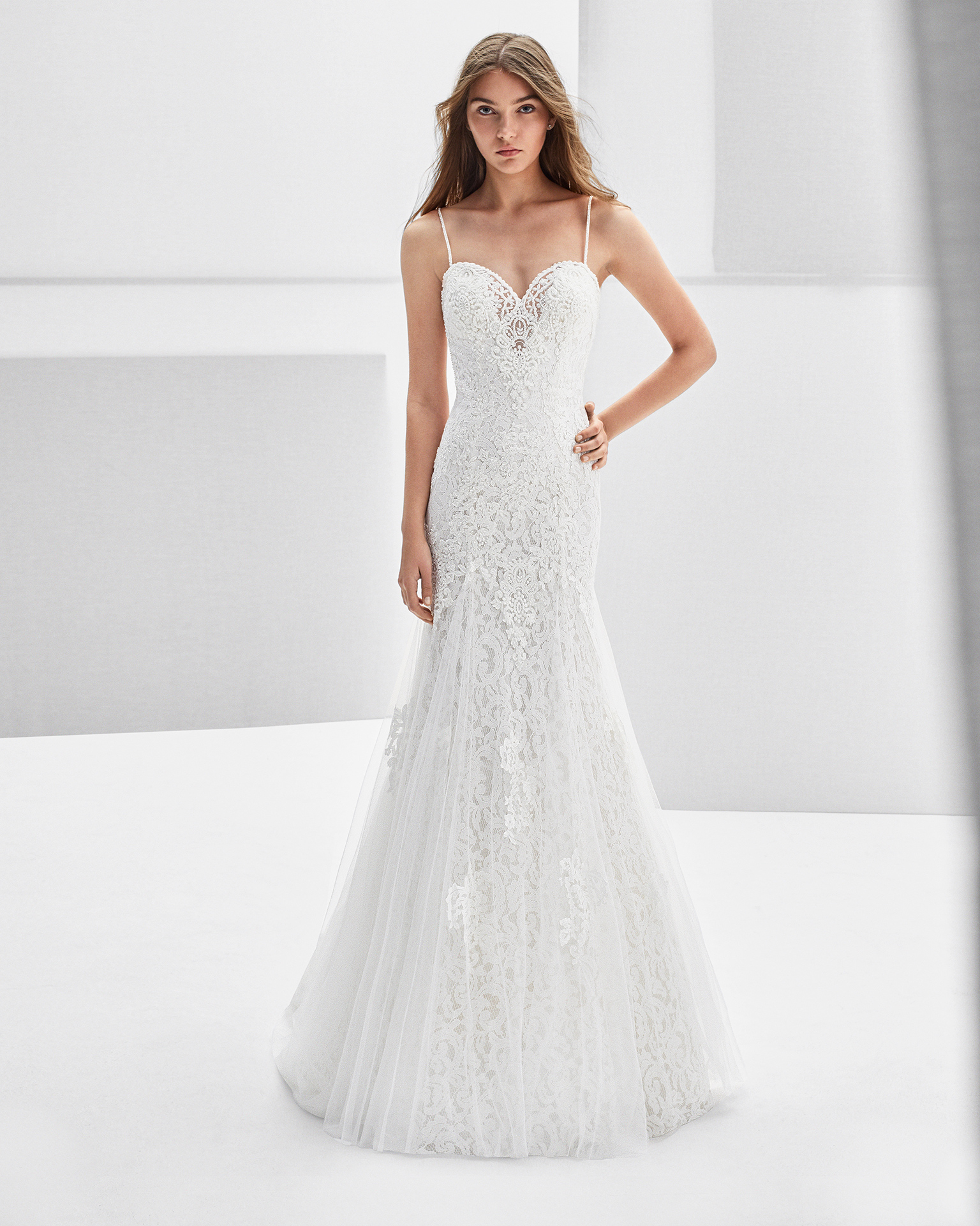 Mermaid-style beaded lace wedding dress with sweetheart neckline, low back and lace appliqués.
