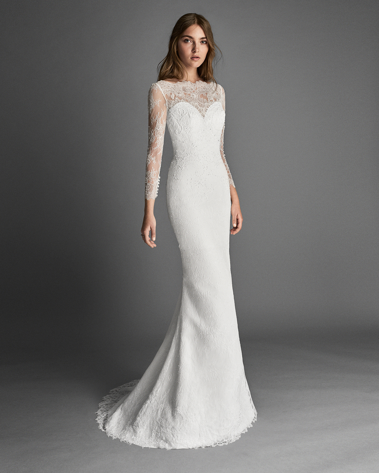 Princess-style beaded lace wedding dress with long sleeves and beaded lace back.