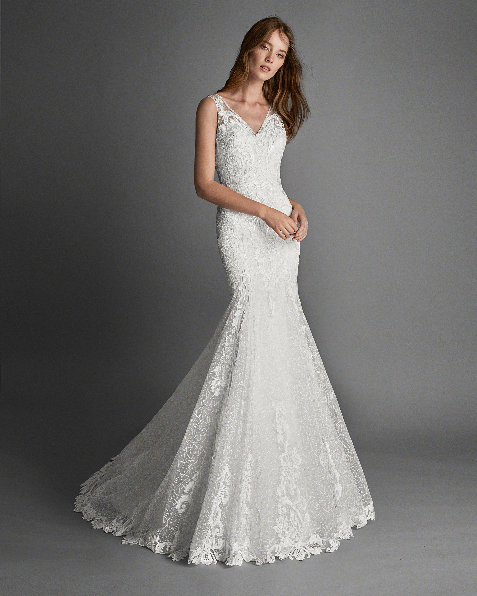 Mermaid-style beaded lace wedding dress with lace back.