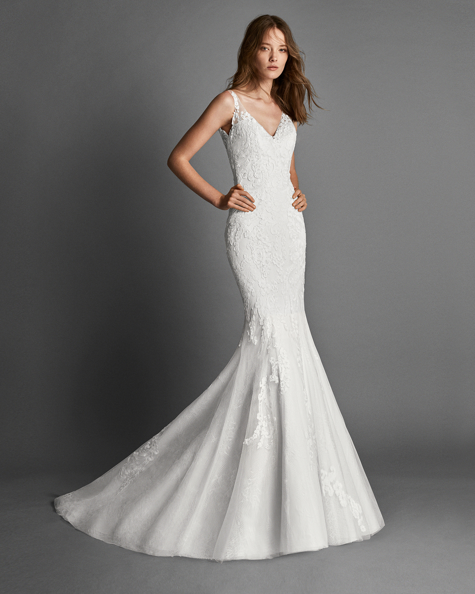 Princess-style beaded lace wedding dress with lace back and overskirt.