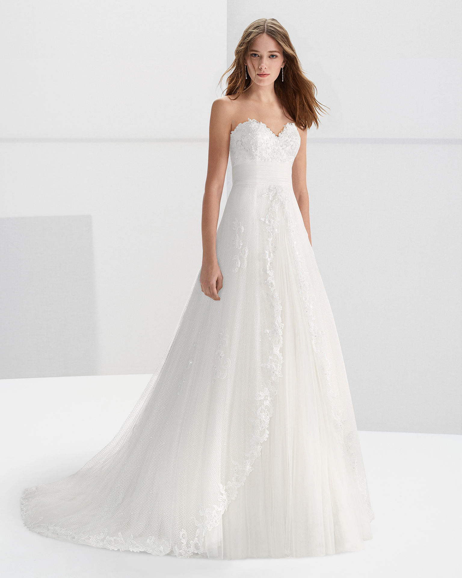 Princess-style beaded guipure lace wedding dress with sweetheart neckline.
