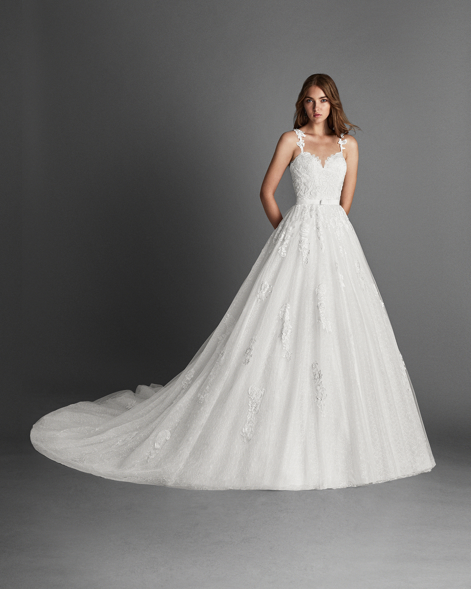 Princess-style lace and tulle wedding dress with sweetheart neckline and low back with beadwork detail.