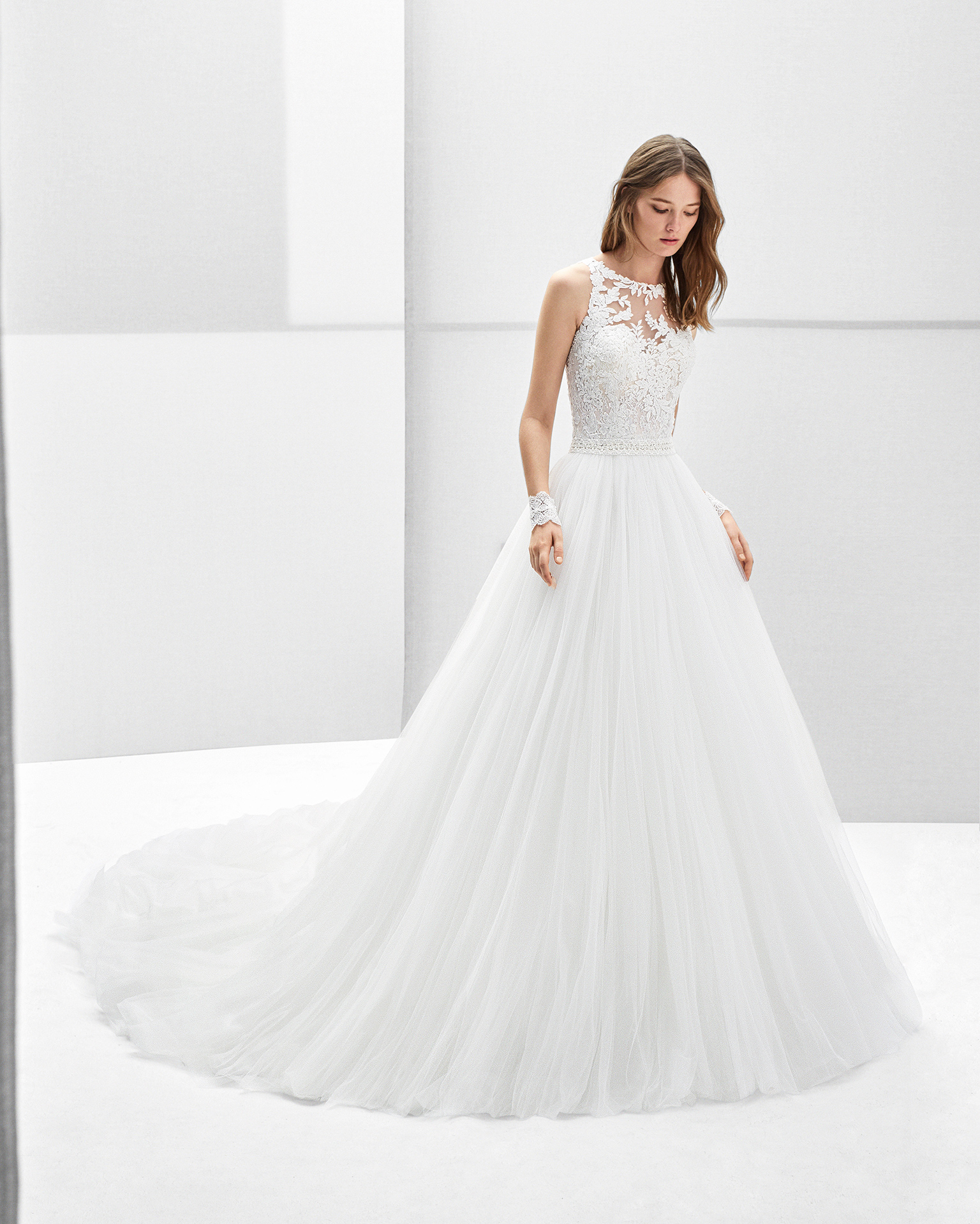 Princess-style tulle and lace wedding dress with halter neckline and beadwork detail, in natural.