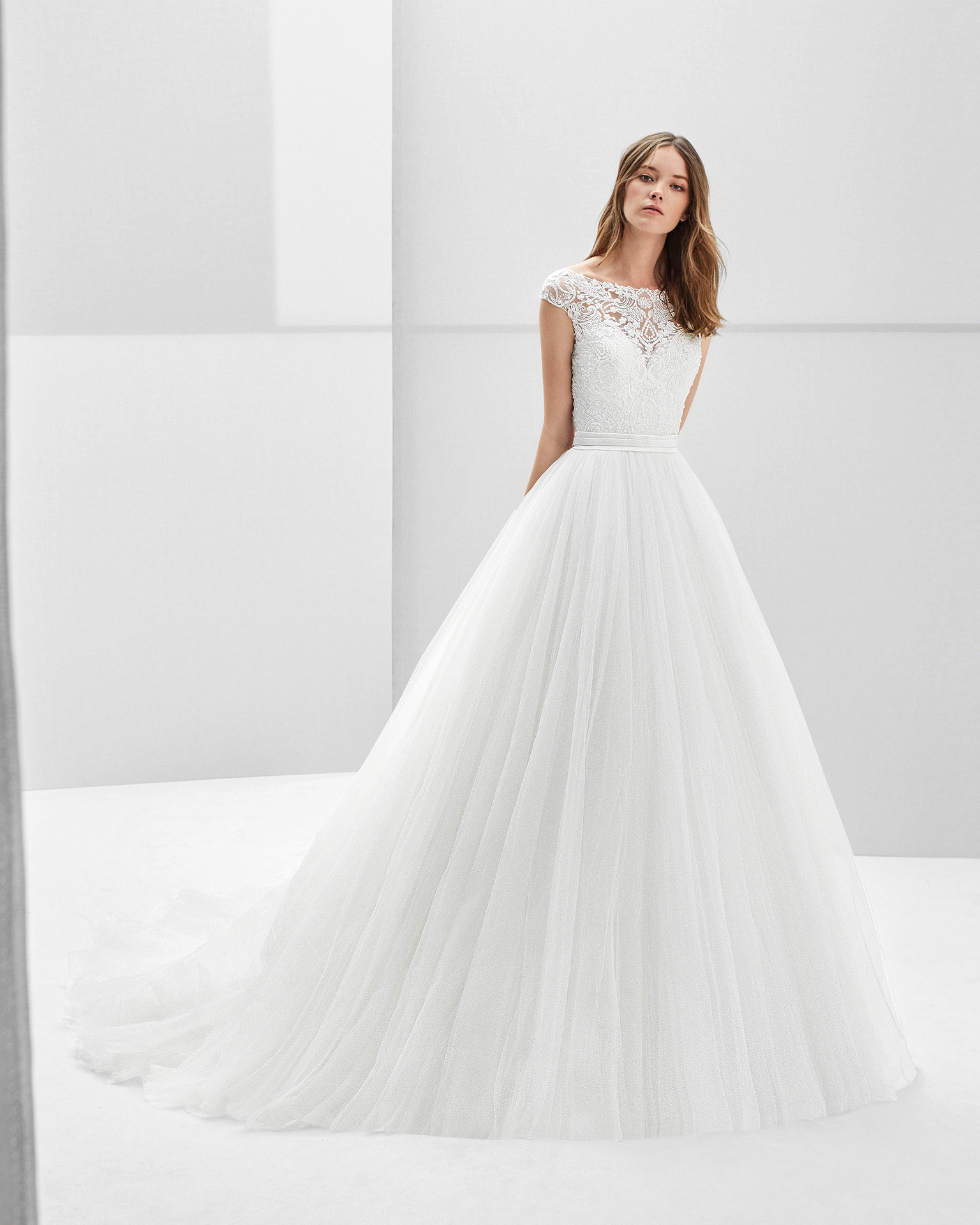 Princess-style beaded lace and tulle wedding dress with short sleeves and low back.