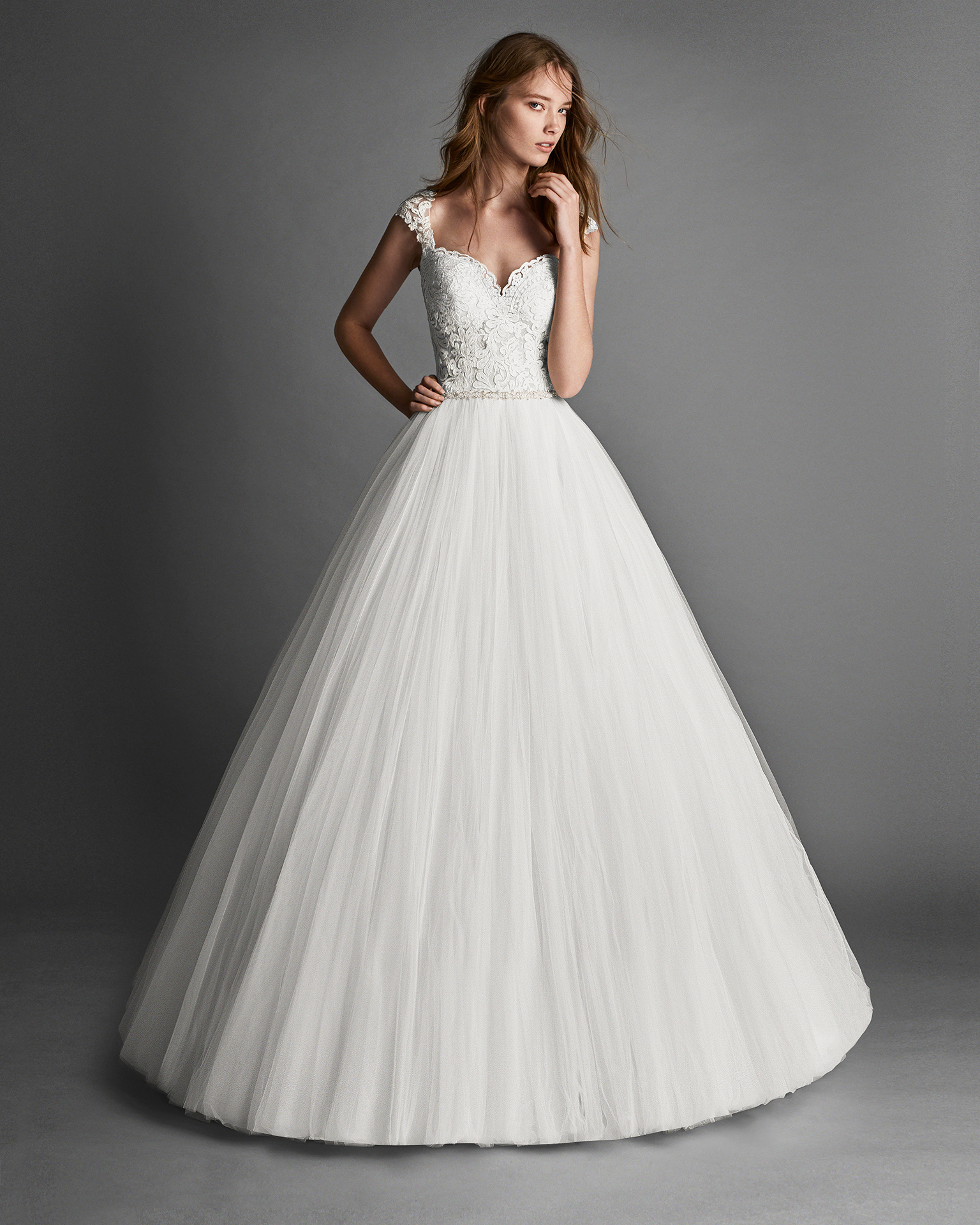 Princess-style beaded lace and tulle wedding dress with lace back.