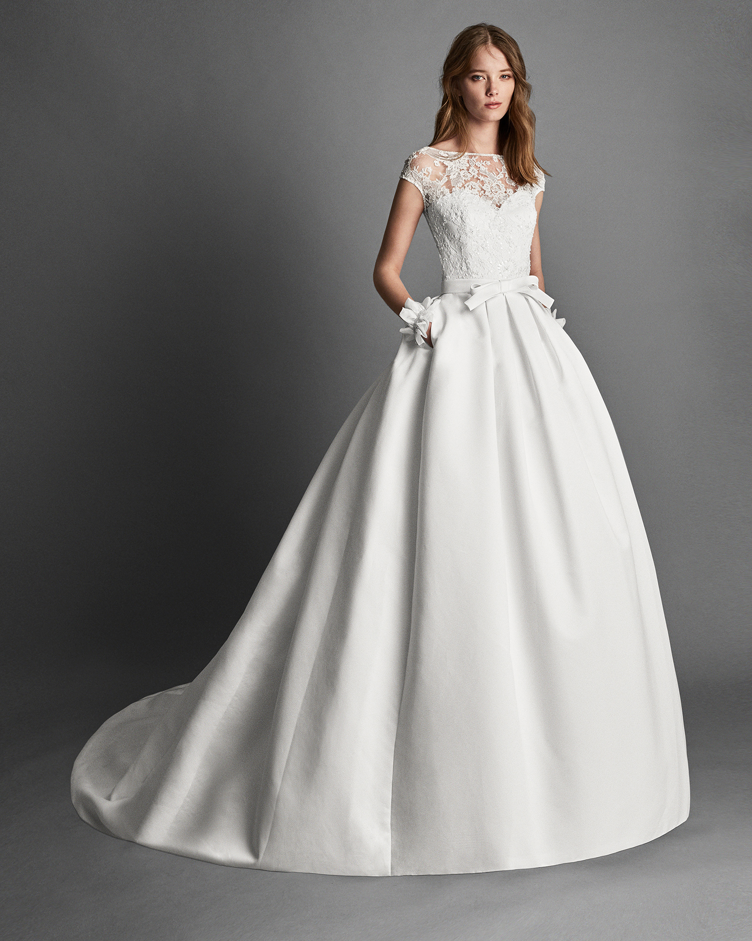 Classic-style beaded lace and Ottoman wedding dress with short sleeves, bateau neckline and pockets, in ivory.