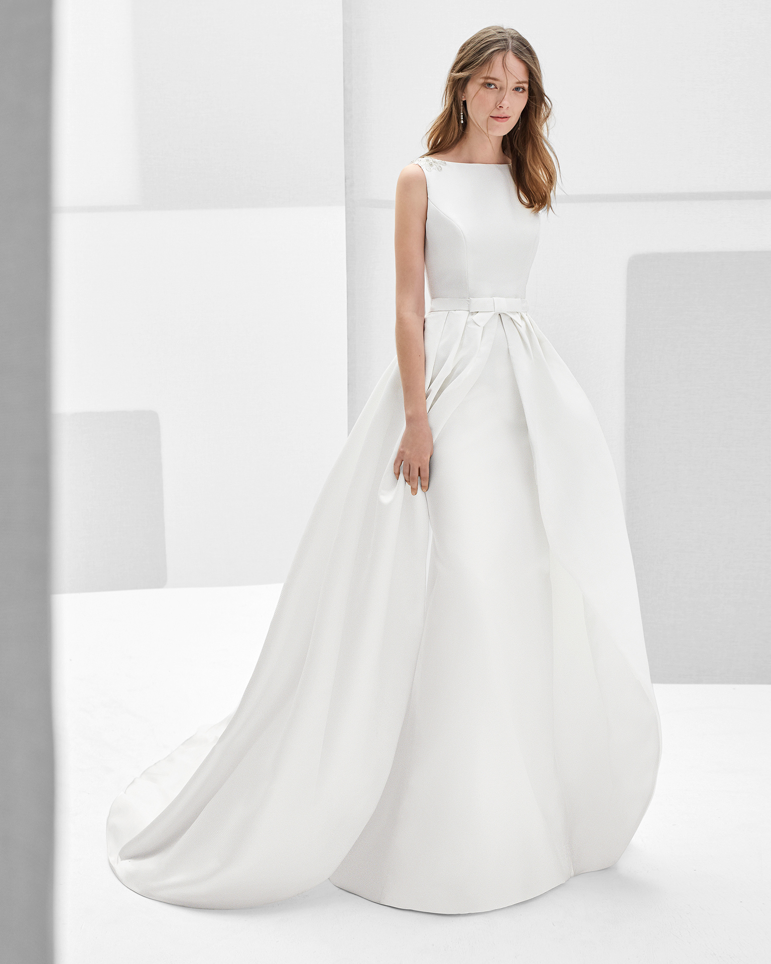 Classic-style beaded Ottoman wedding dress with bateau neckline, jewelled back and overskirt, in natural.