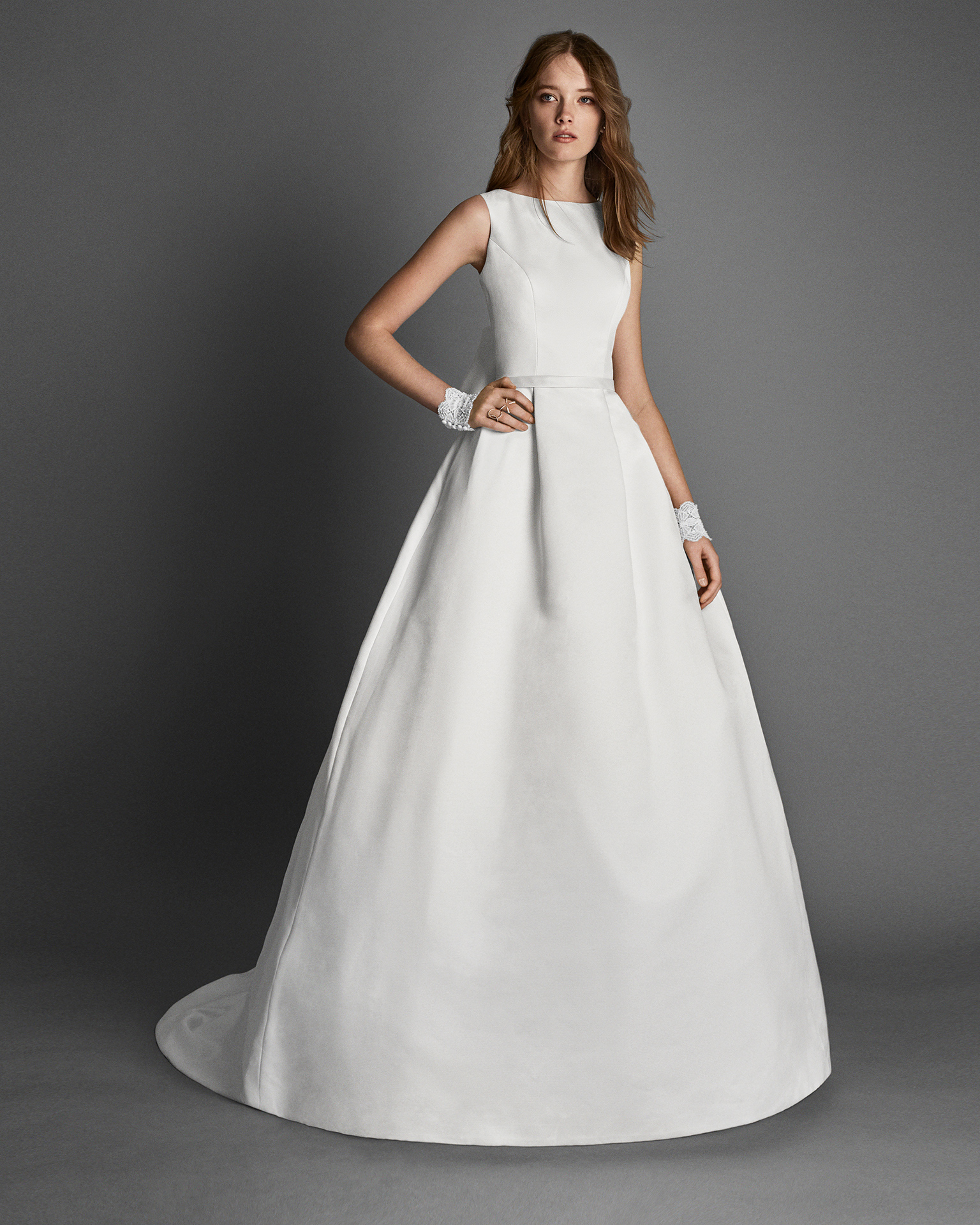 Classic-style beaded Ottoman wedding dress with jewelled back, in natural.