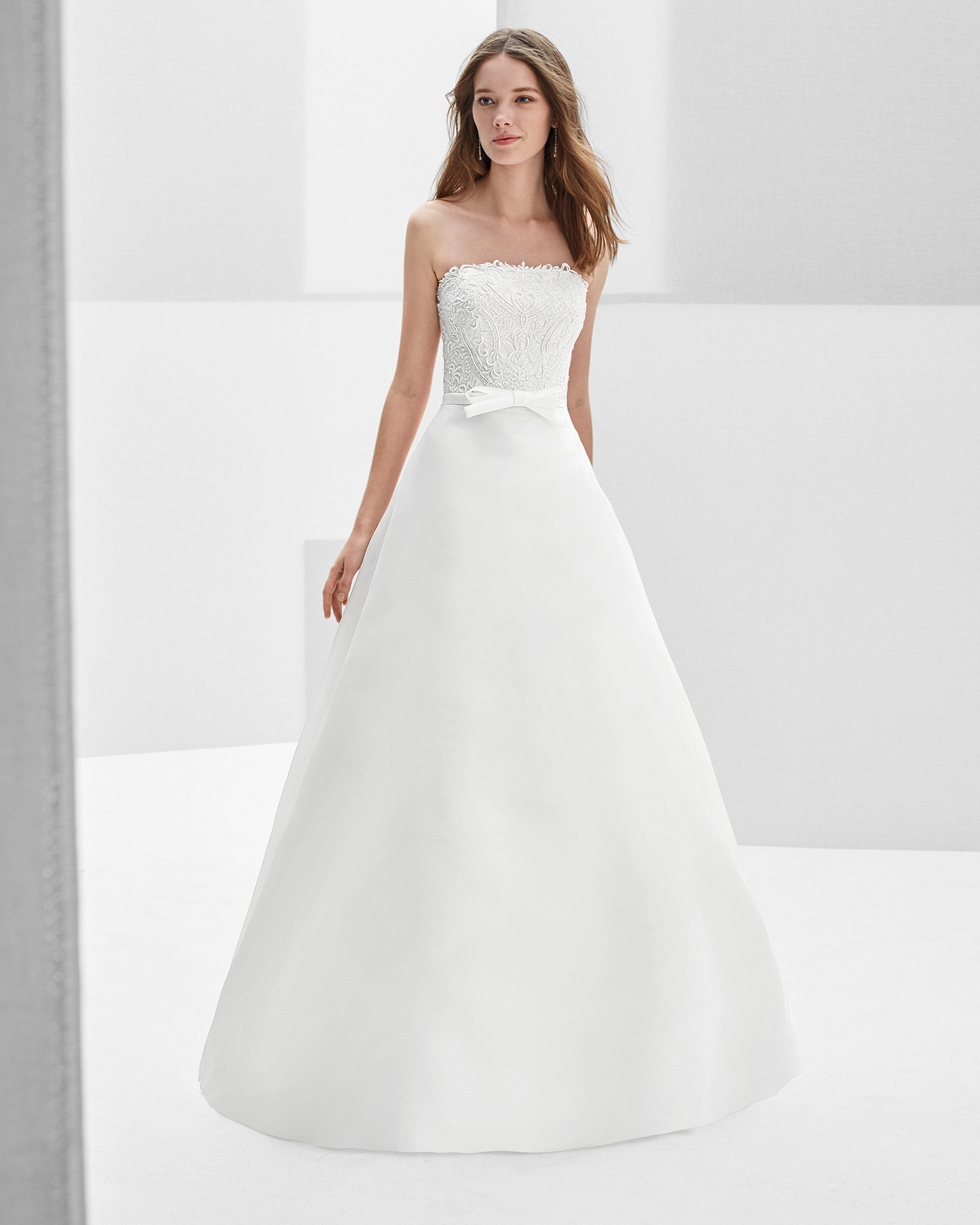 Classic-style beaded organza strapless wedding dress.