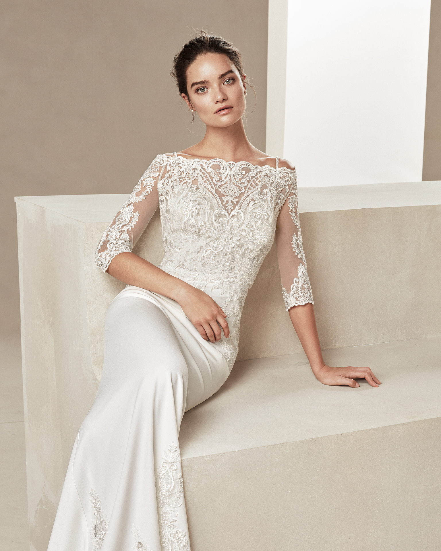 Beaded sheath-style wedding dress in crepe and lace. With sweetheart neckline and beaded straps. Available in natural. 2019 ALMANOVIA Collection.