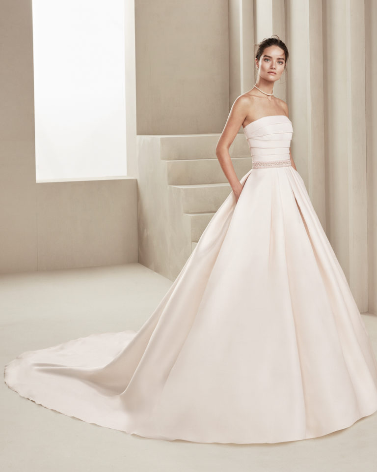 Classic gazar wedding dress. With strapless neckline and beading at the waist. Available in rose and natural. 2019 ALMANOVIA Collection.