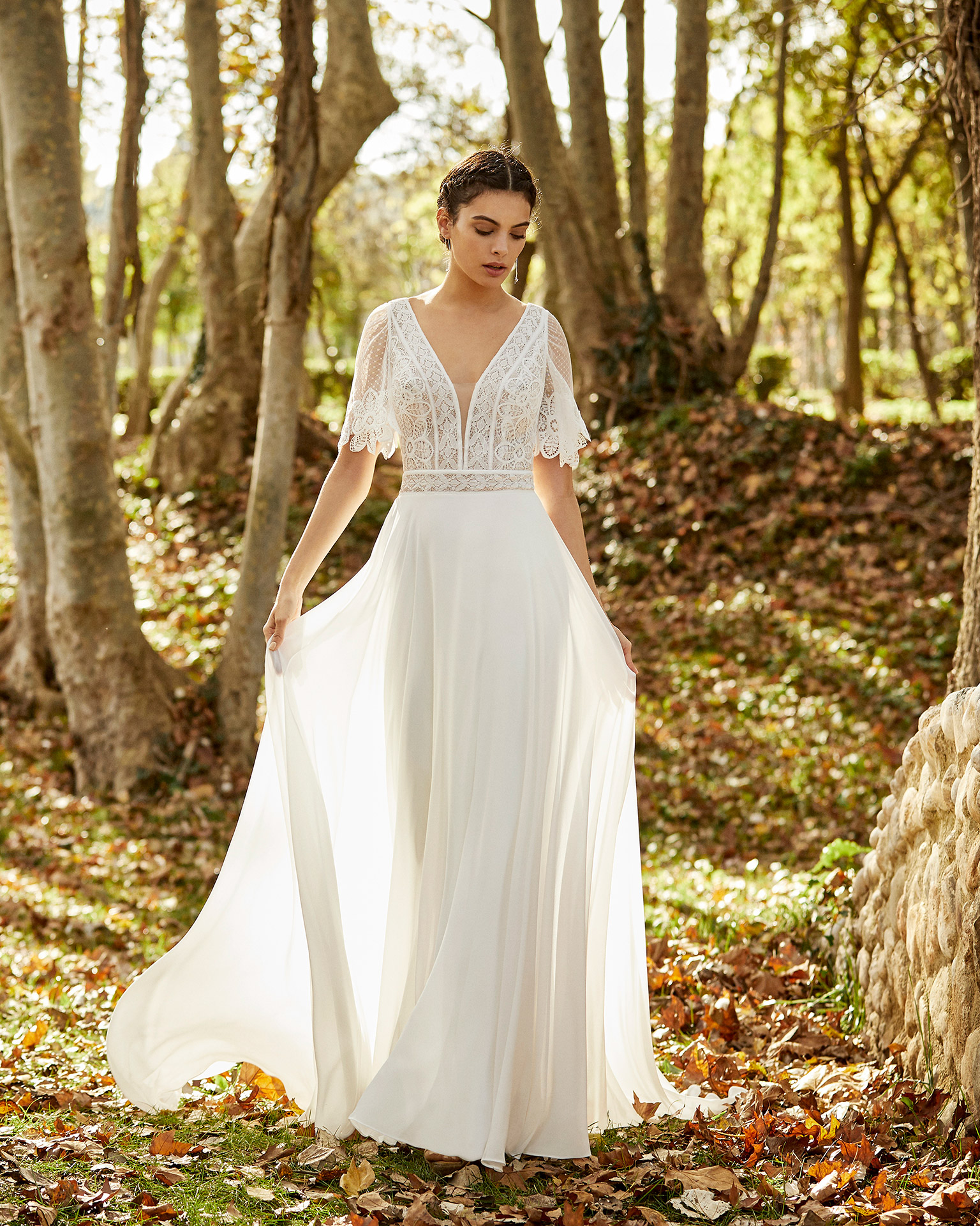 Boho-style lace and chiffon wedding dress with deep-plunge neckline, V-back and short sleeves. 2020 ALMANOVIA Collection.