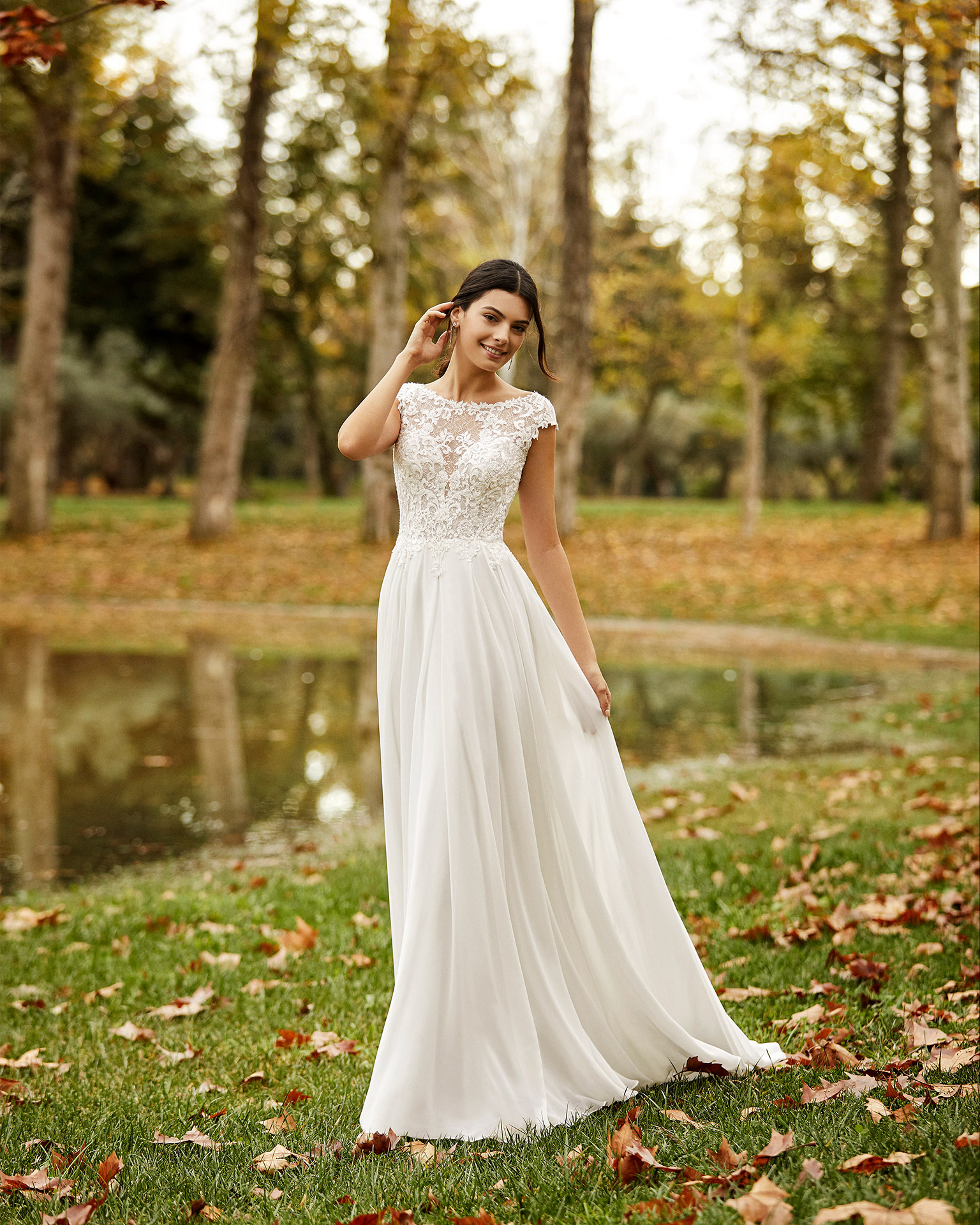 Boho-style lace and chiffon wedding dress with beading and low back. 2020 ALMANOVIA Collection.