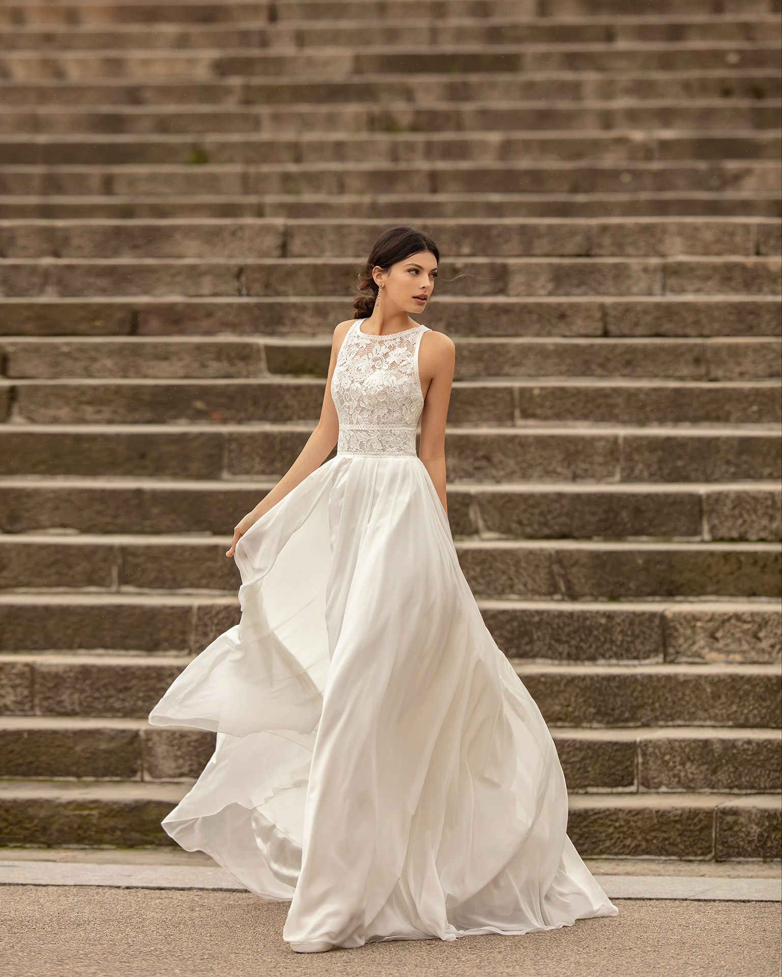 Lightweight chiffon and corded lace wedding dress with back with crossover straps. 2020 ALMANOVIA Collection.