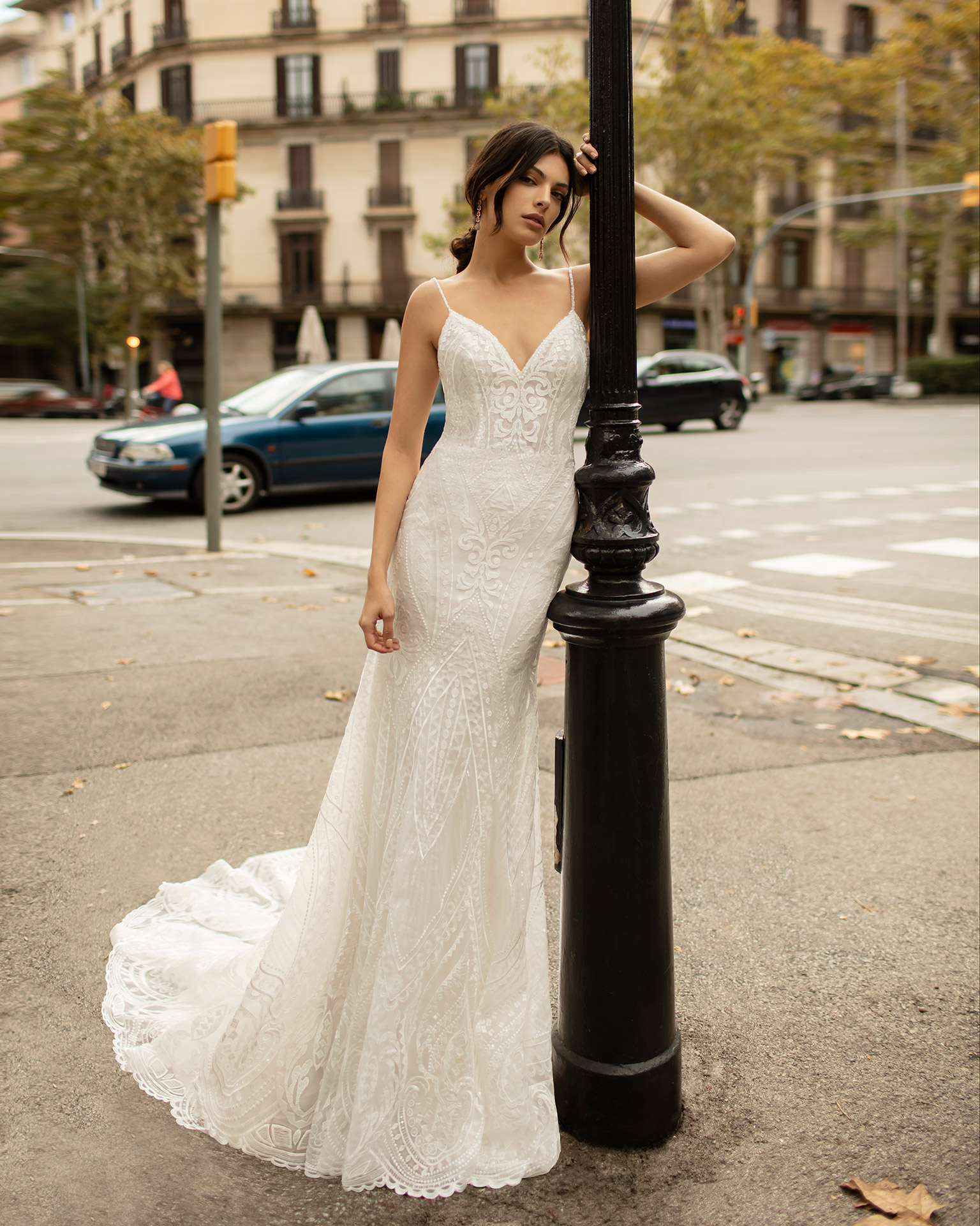 Mermaid-style beaded lace wedding dress with V-neckline and low back. 2020 ALMA_NOVIA Collection.