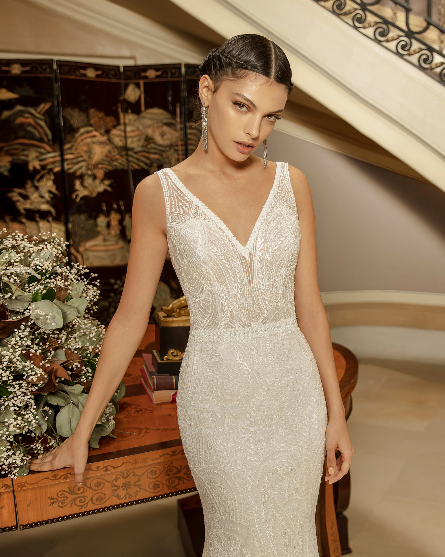 Mermaid-style beaded lace wedding dress with V-neckline and low back. 2020 ALMANOVIA Collection.