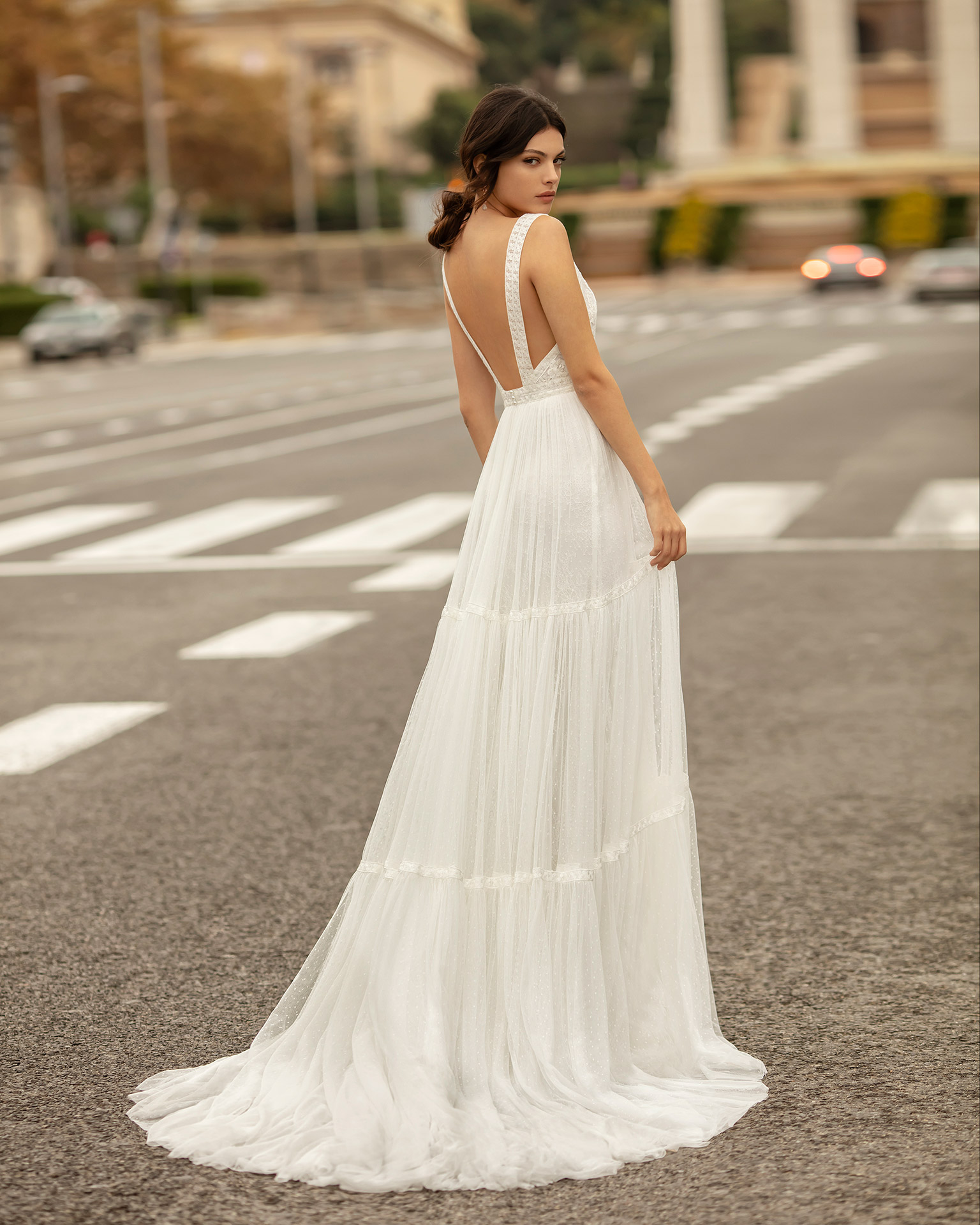Boho-style dot tulle and lace wedding dress with V-neckline and low back. 2020 ALMA_NOVIA Collection.