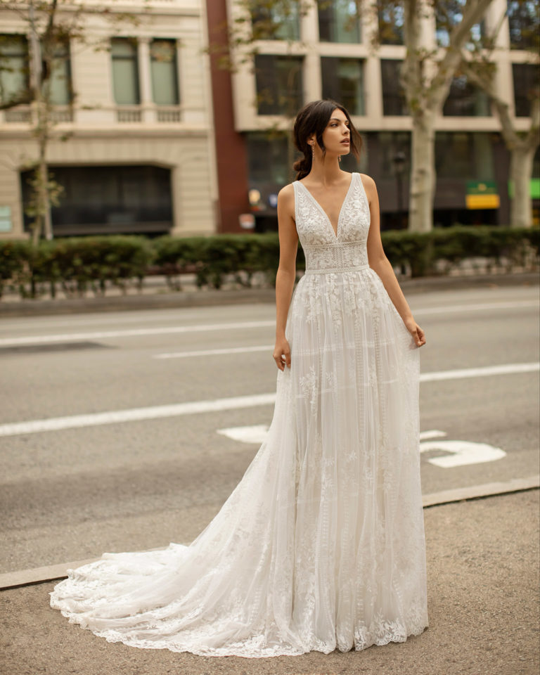 Boho-style lace and tulle wedding dress with beading, deep-plunge neckline and low back. 2020 ALMANOVIA Collection.