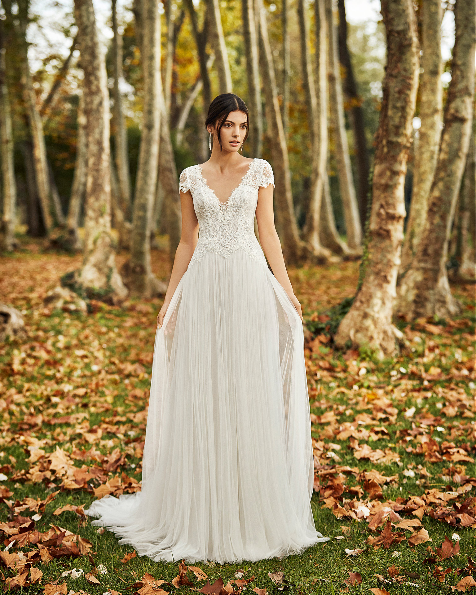 Lightweight pleated soft tulle and lace wedding dress with illusion neckline and back. 2020 ALMANOVIA Collection.