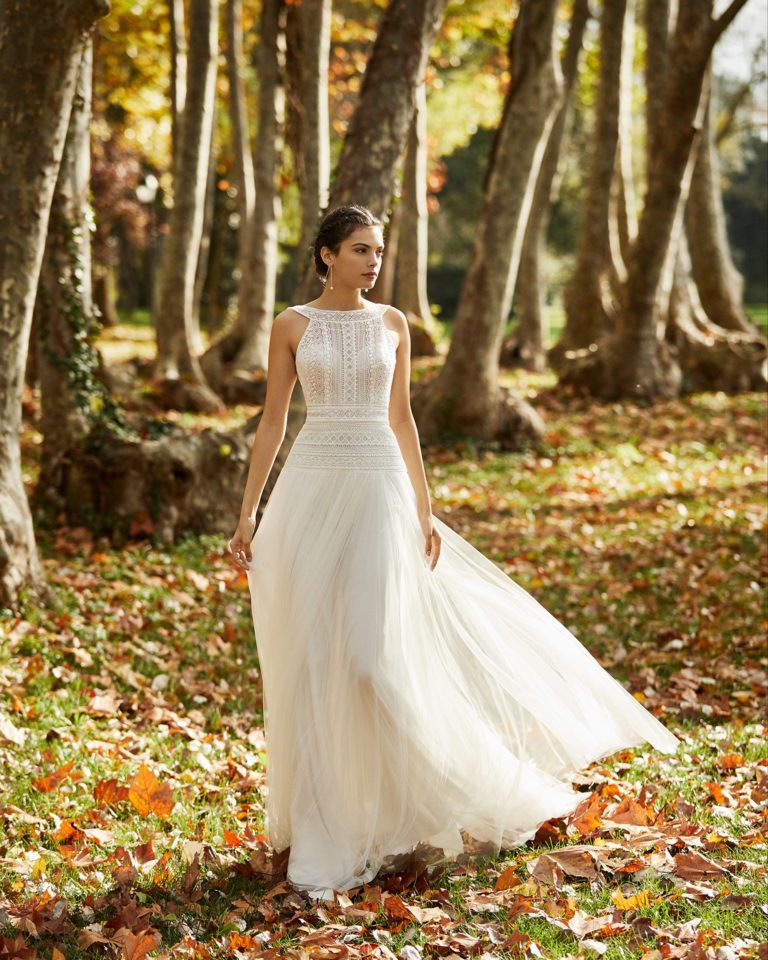 Wedding dress in lightweight soft tulle pleated at the hip, lace and beading with low back. 2020 ALMA_NOVIA Collection.