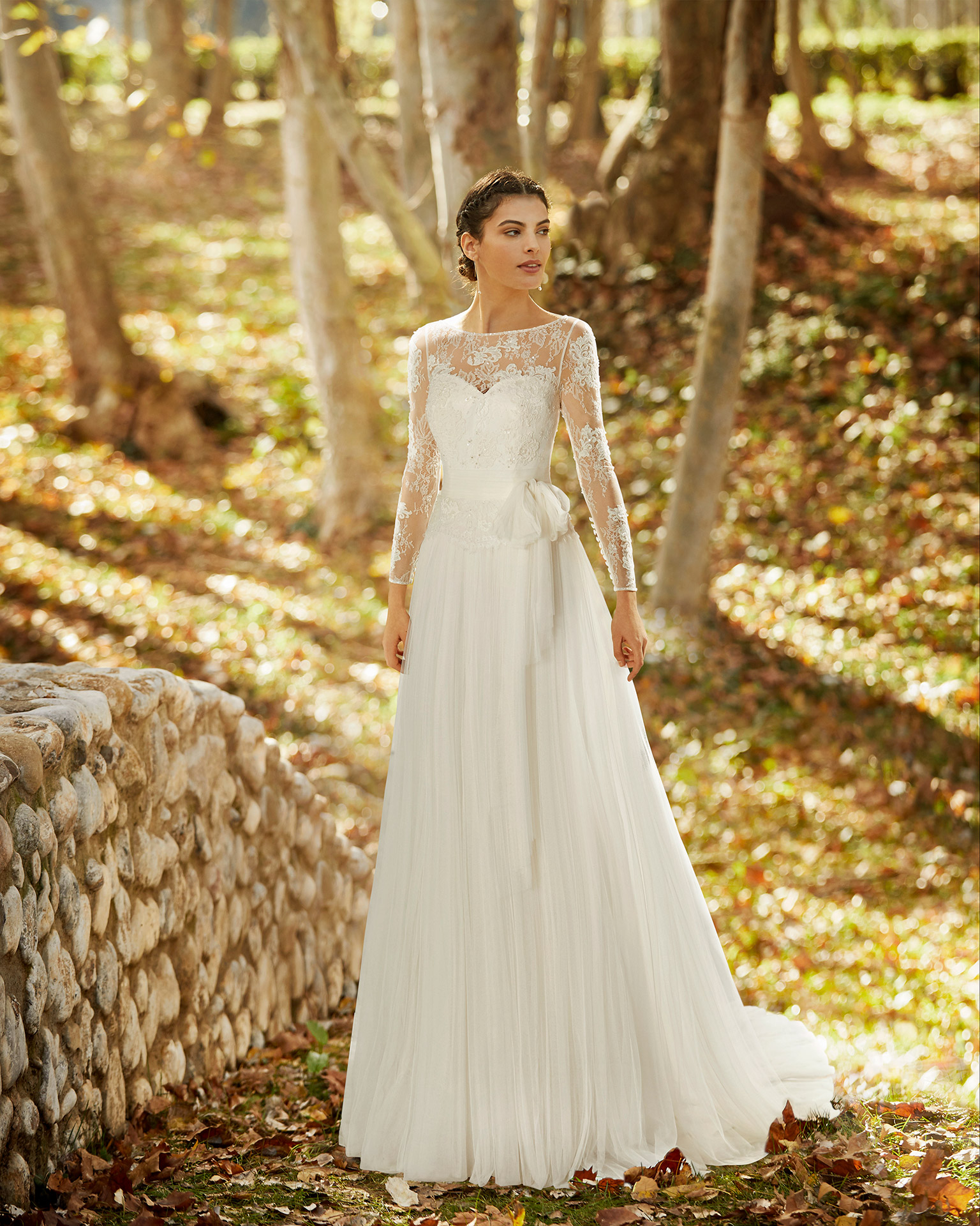 Romantic soft tulle and lace wedding dress with beading and neckline and back with sheer inserts. 2020 ALMANOVIA Collection.