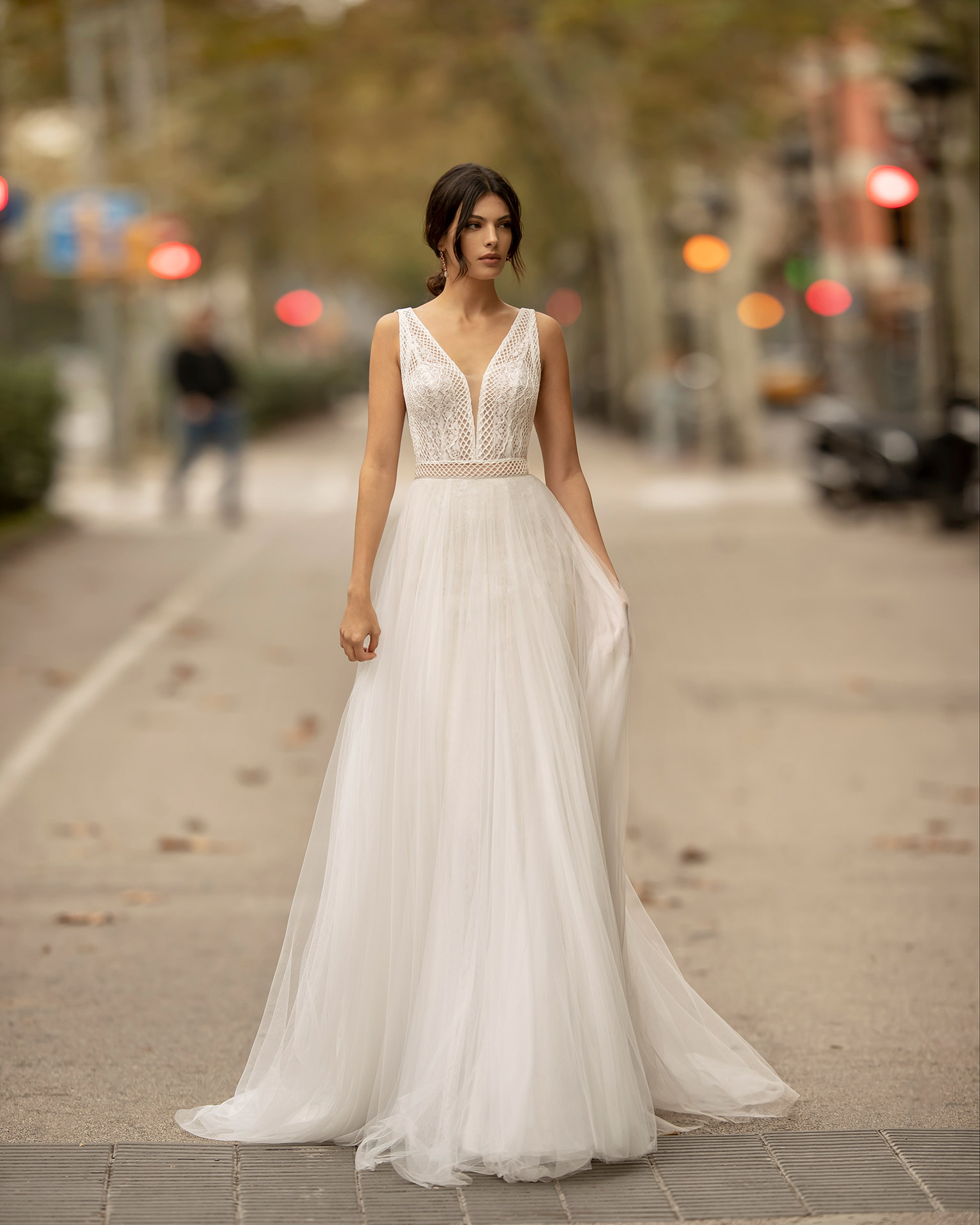 Romantic lace and soft tulle wedding dress with deep-plunge neckline and V-back. 2020 ALMA_NOVIA Collection.