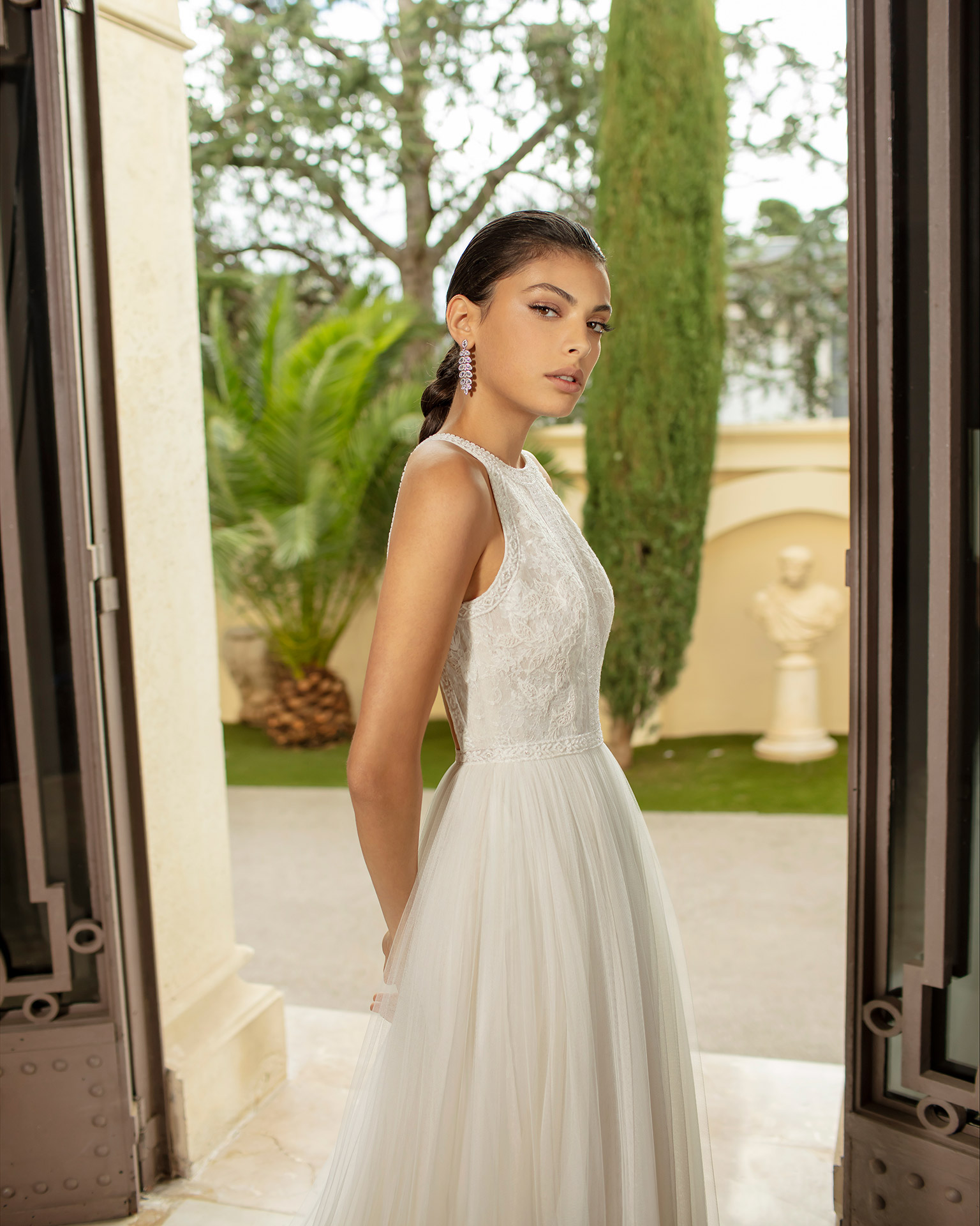 Romantic wedding dress in soft tulle, lace and beading with low back. 2020 ALMANOVIA Collection.