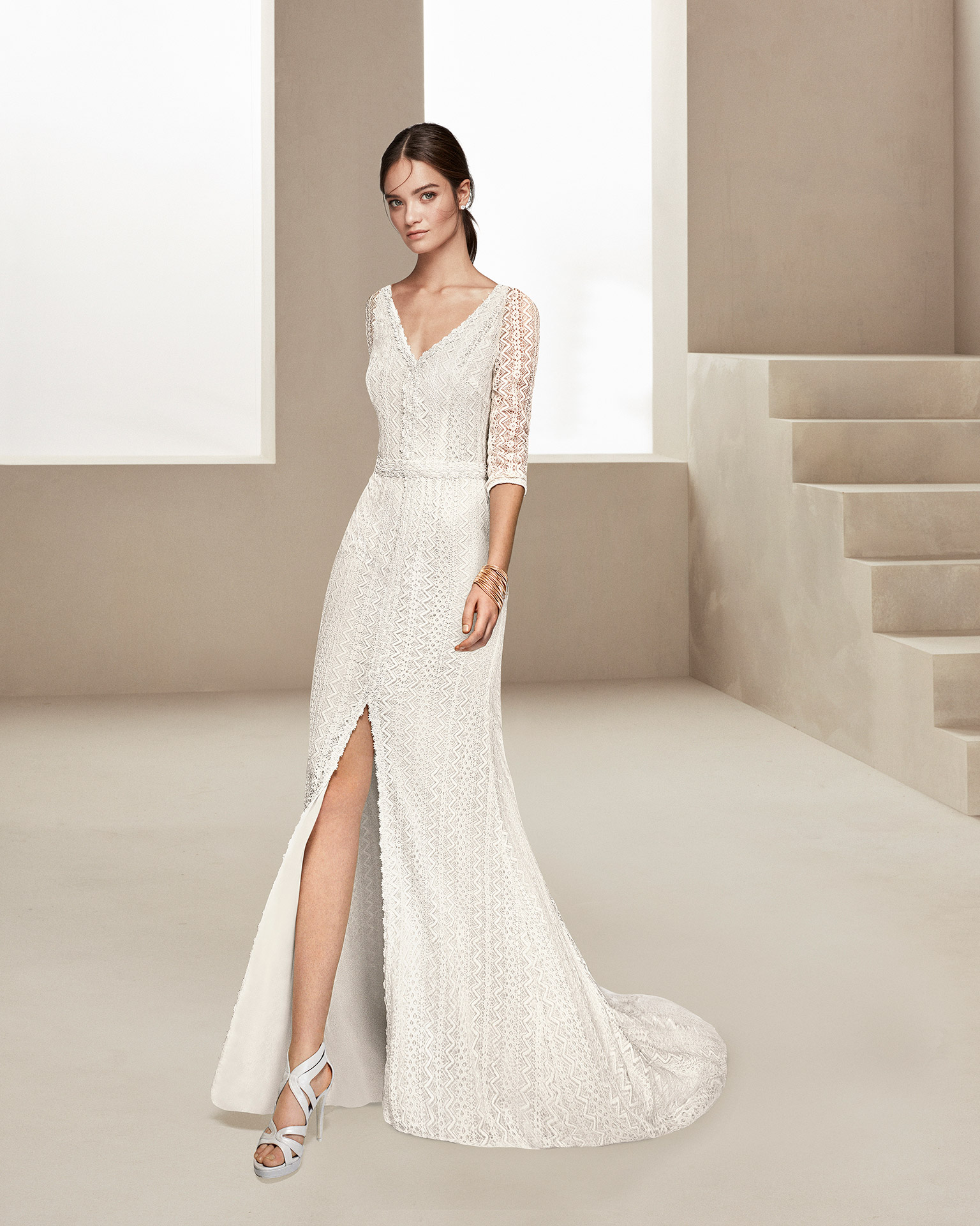 Boho-style beaded lace wedding dress with three-quarter sleeves and front opening. 2020 ALMANOVIA Collection.