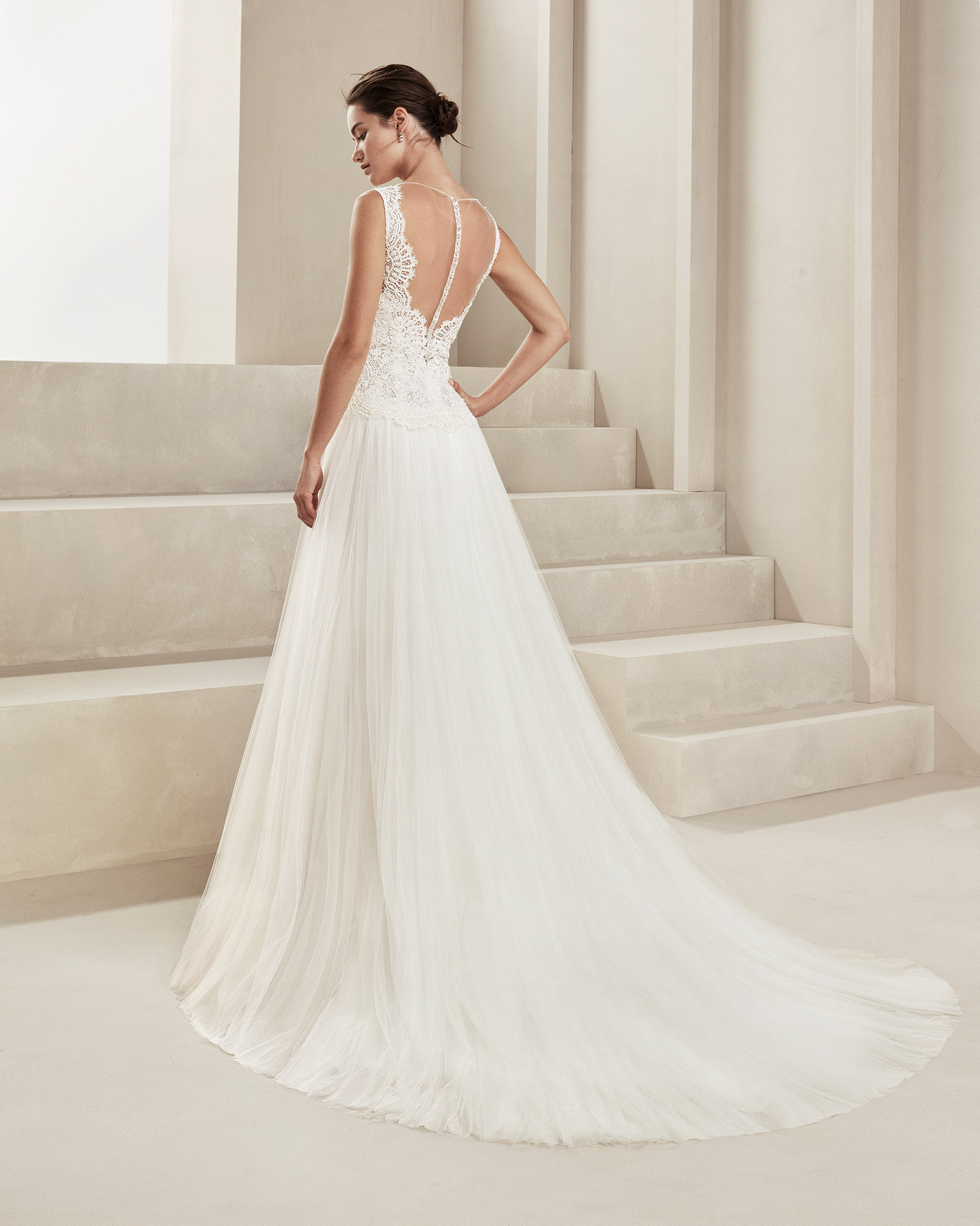 Romantic soft tulle and beaded lace wedding dress. With V-neckline and tulle back. Available in natural. 2020 ALMANOVIA Collection.