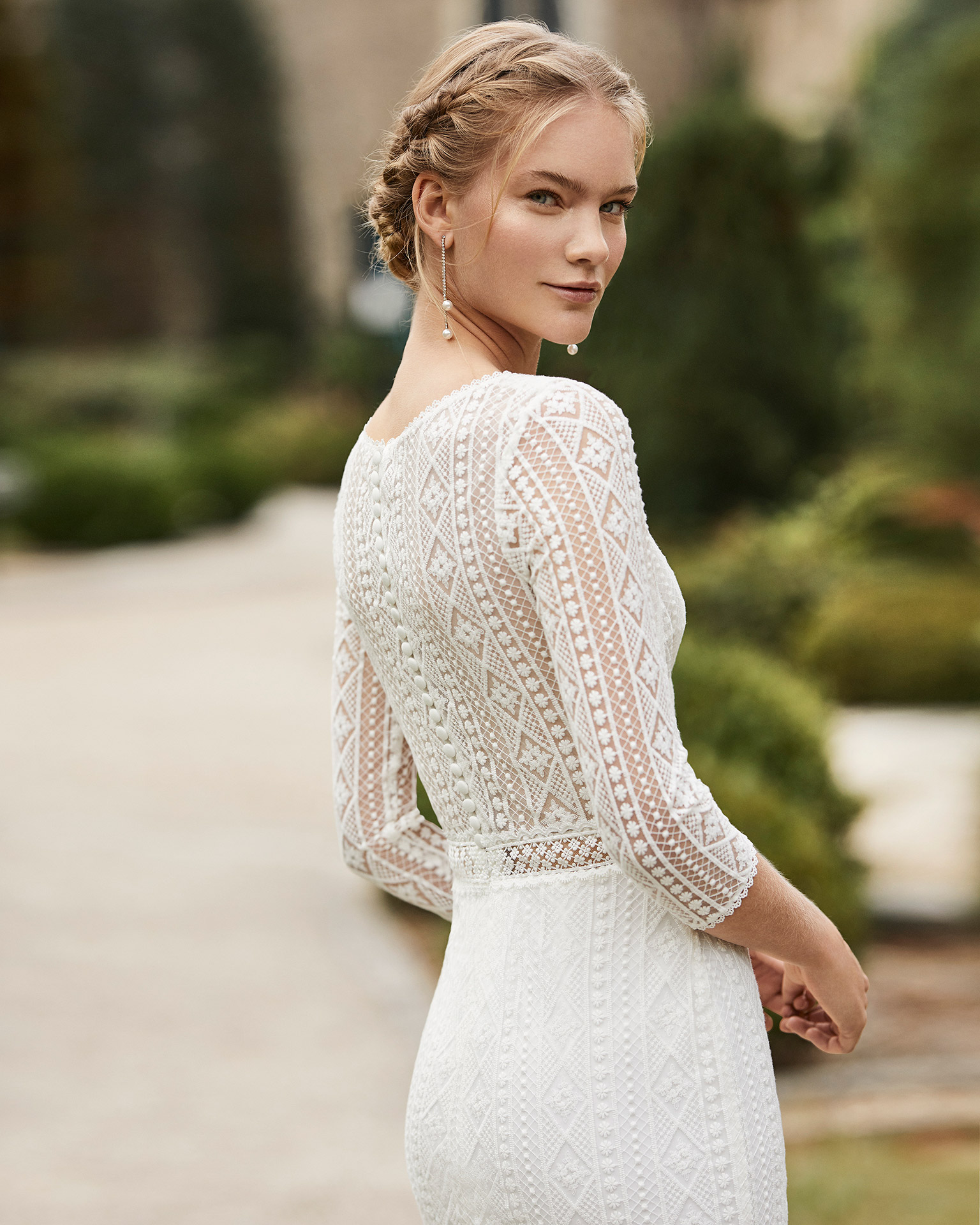 Lace wedding dress. V-neckline, three-quarter sleeves in lace, beaded lace belt and closed back in lace. 2021 ALMANOVIA Collection.